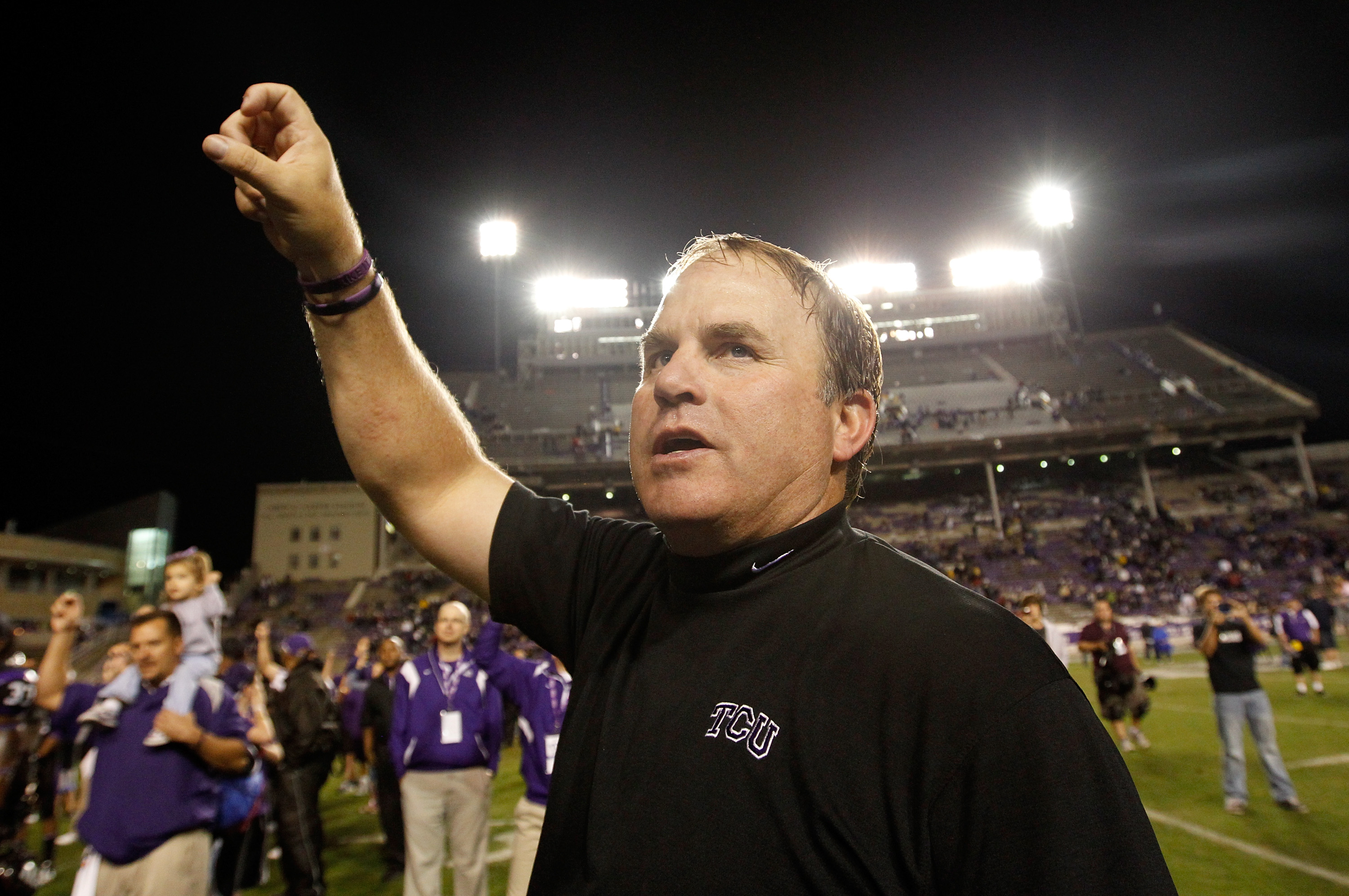 FORT WORTH, TX - OCTOBER 23:  Head coach Gary Patterson of the TCU Horned Frogs celebrates on the field after TCU beat the Air Force Falcons 38-7 at Amon G. Carter Stadium on October 23, 2010 in Fort Worth, Texas.  (Photo by Tom Pennington/Getty Images)