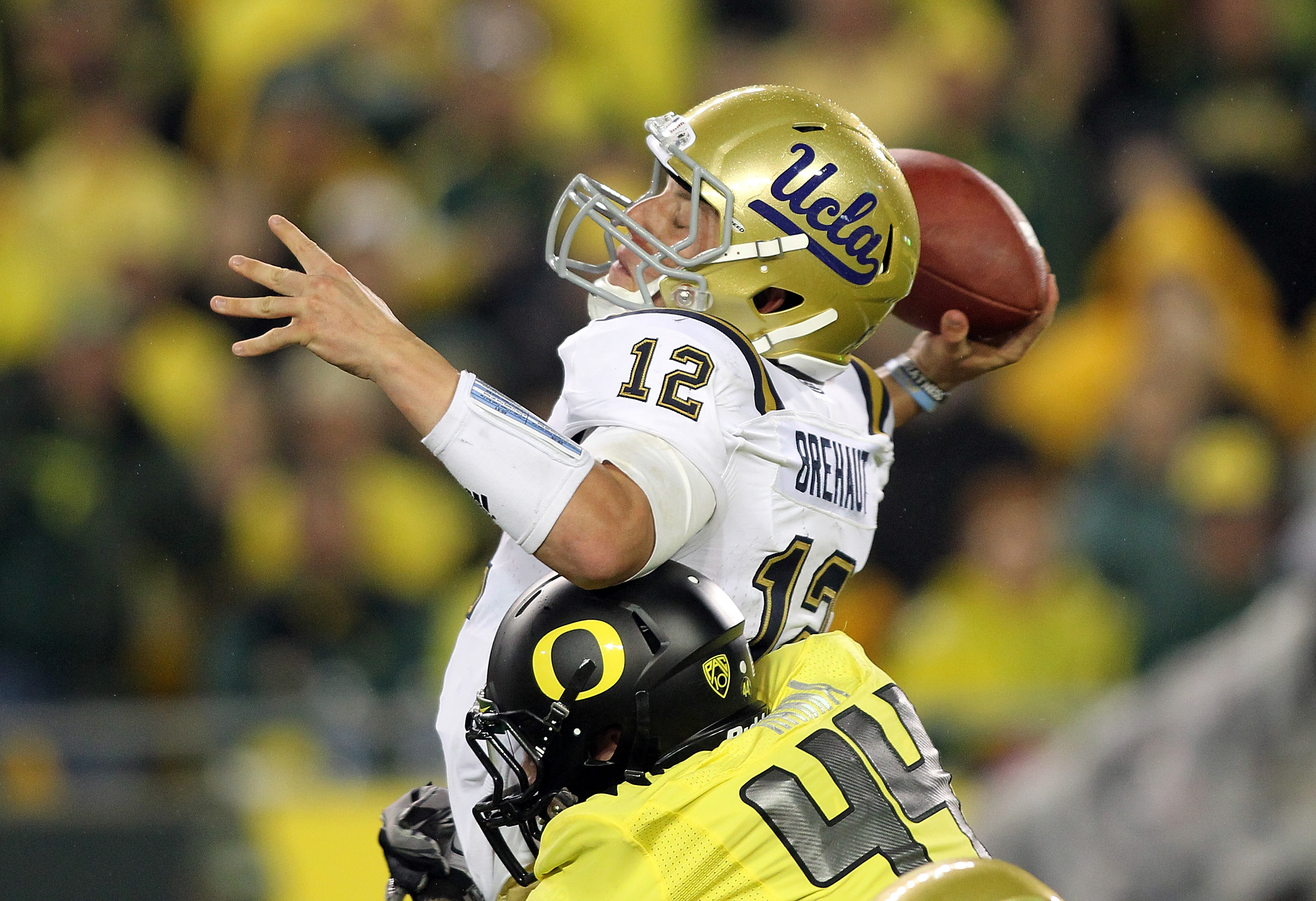 EUGENE, OR - OCTOBER 21:  Richard Brehaut #12 of the UCLA Bruins  is sacked by Brandon Hanna #44 of the Oregon Ducks on October 21, 2010 at the Autzen Stadium in Eugene, Oregon.  (Photo by Jonathan Ferrey/Getty Images)