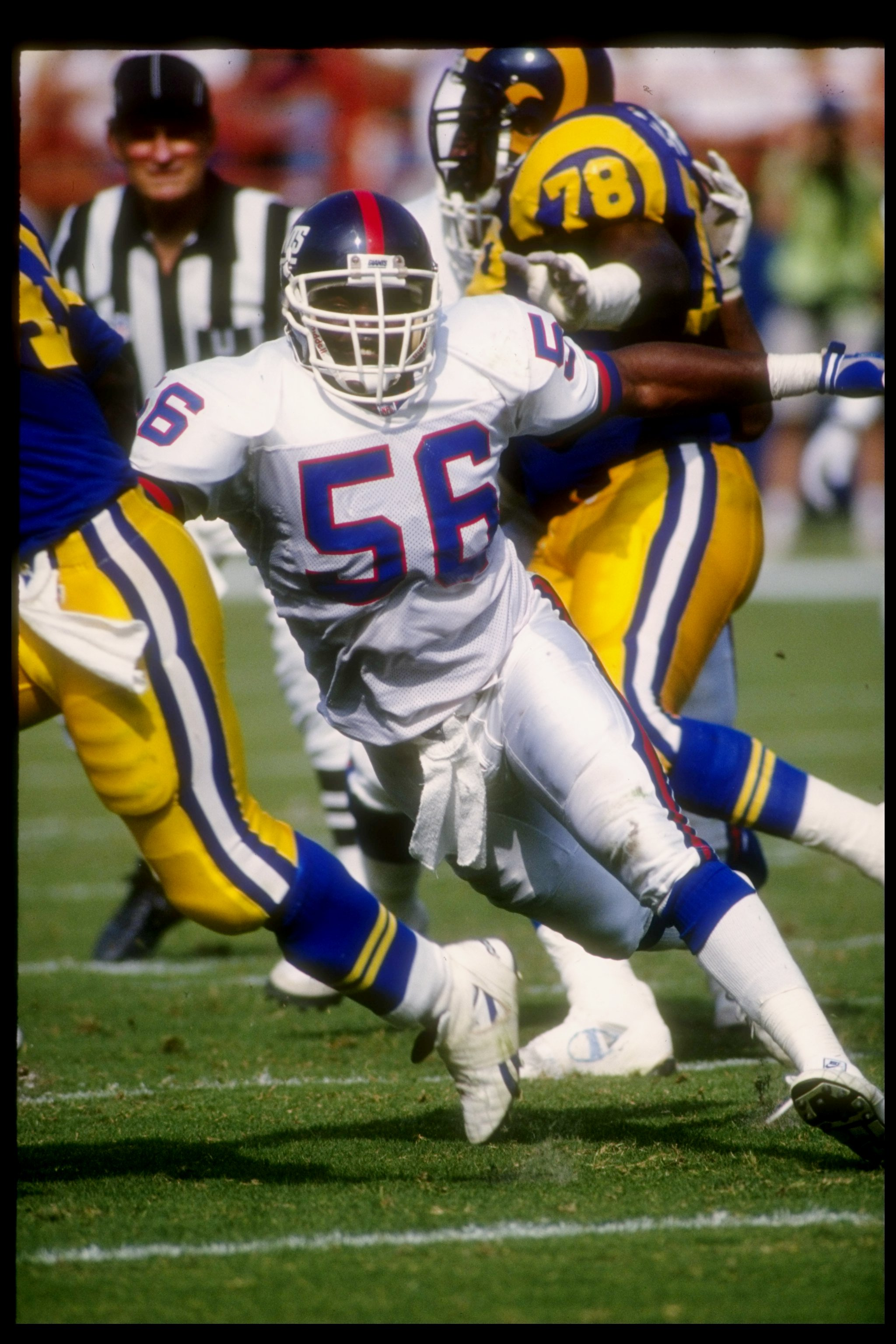 18 Oct 1992:  Linebacker Lawrence Taylor of the New York Giants moves down the field during a game against the Los Angeles Rams at Anaheim Stadium in Anaheim, California.  The Rams won the game, 38-17. Mandatory Credit: Ken Levine  /Allsport