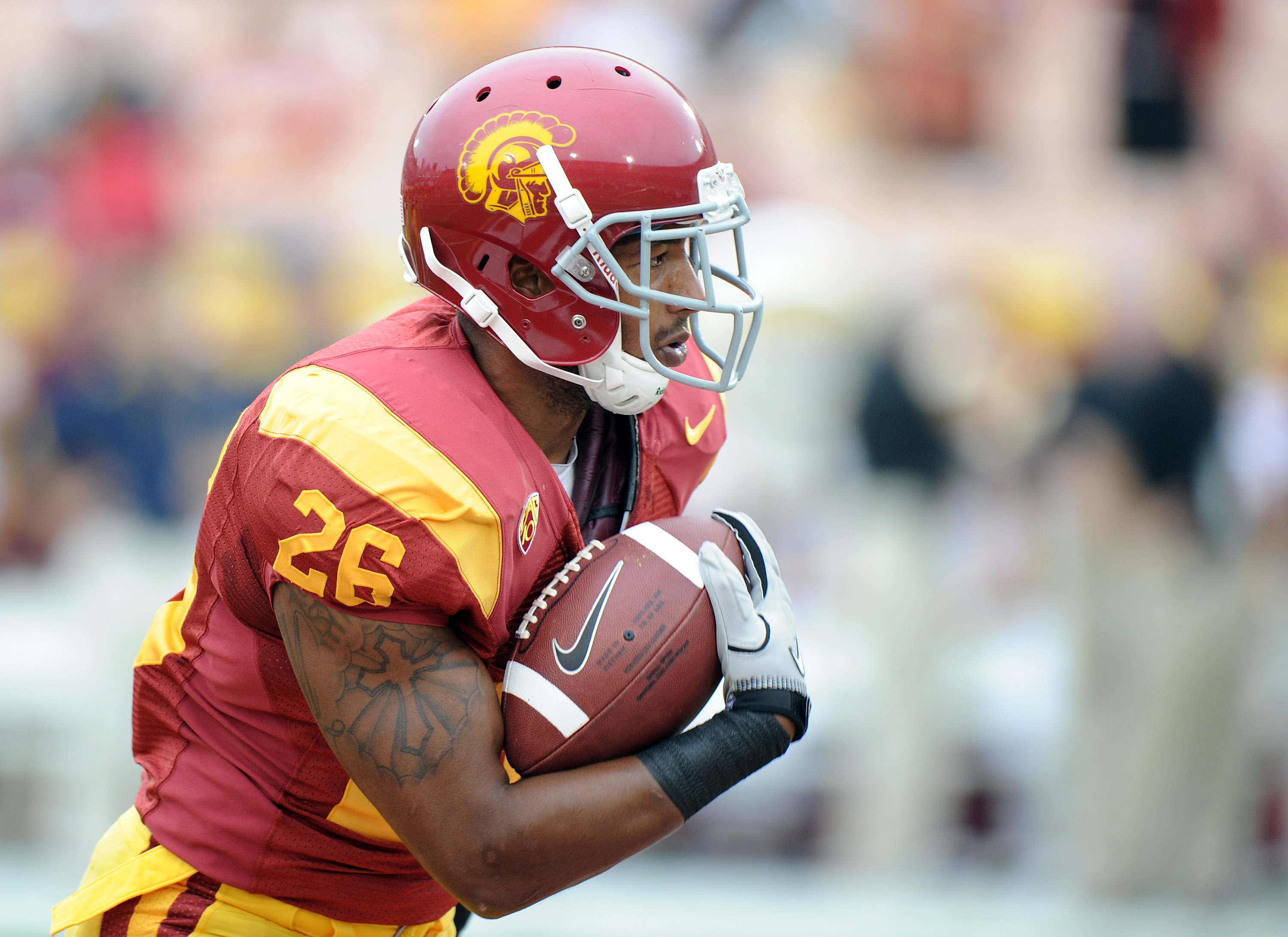 LOS ANGELES, CA - OCTOBER 16:  Marc Tyler #26 of the USC Trojans warms up before the game against the California Golden Bears at Los Angeles Memorial Coliseum on October 16, 2010 in Los Angeles, California.  (Photo by Harry How/Getty Images)