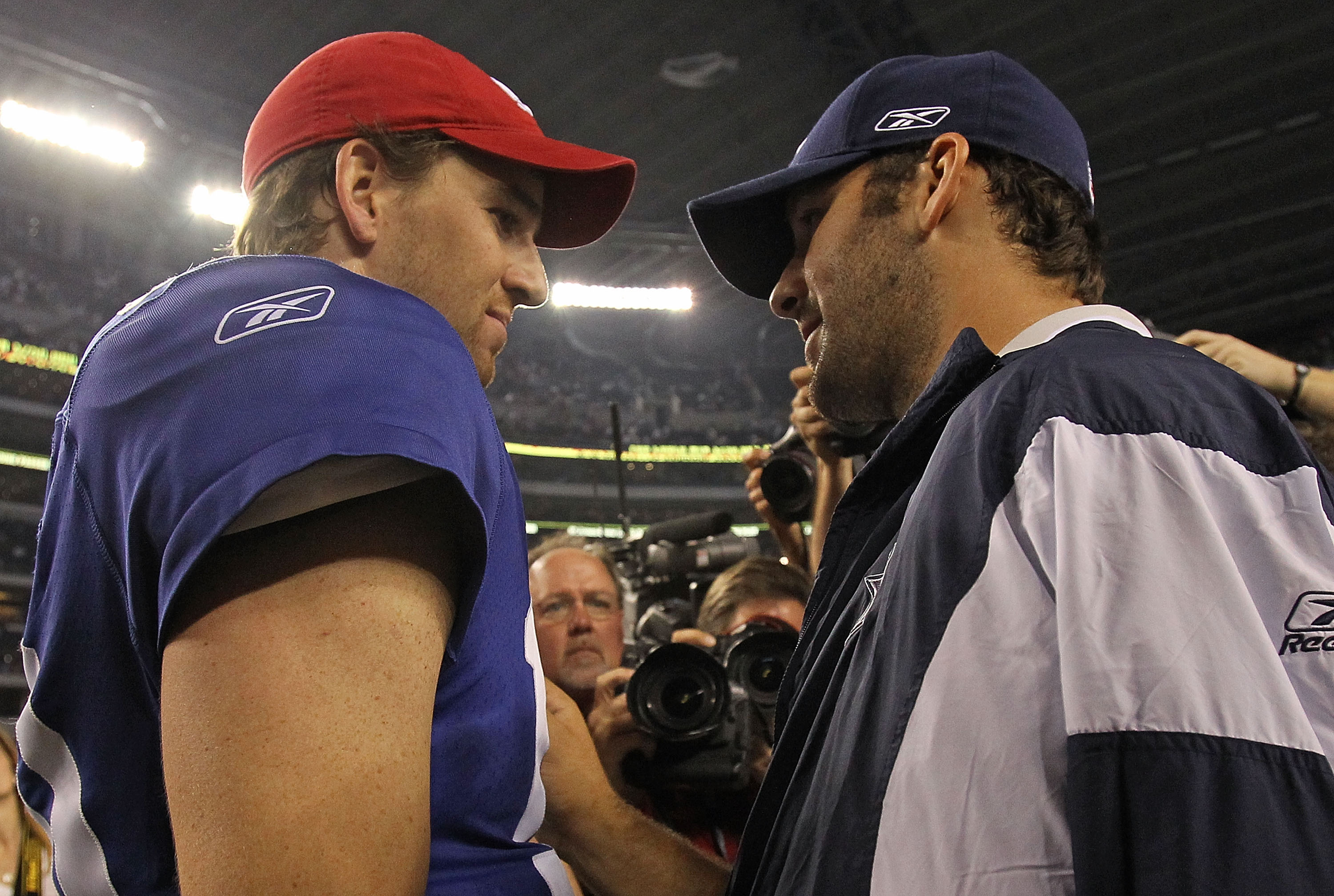 ARLINGTON, TX - OCTOBER 25:  Quarterback Tony Romo #9 of the Dallas Cowboys talks with Eli Manning #10 of the New York Giants after a game at Cowboys Stadium on October 25, 2010 in Arlington, Texas.  (Photo by Ronald Martinez/Getty Images)