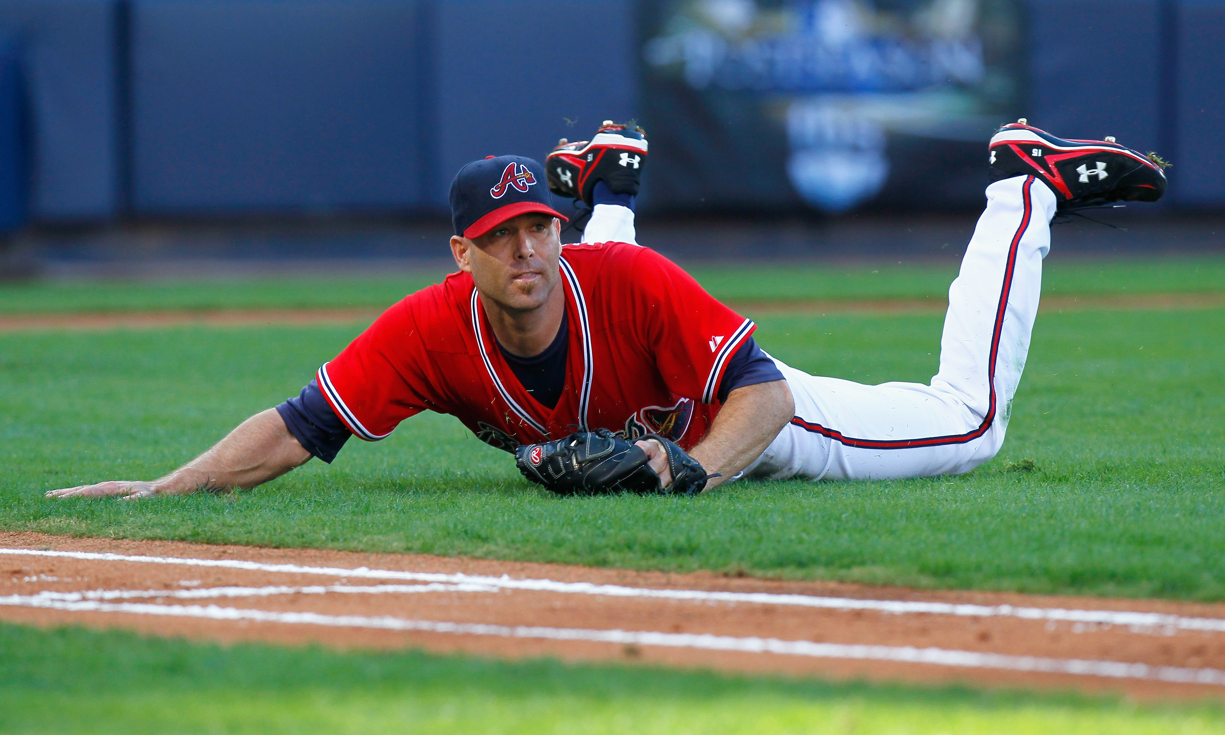 ATLANTA - OCTOBER 10:  Starting pitcher Tim Hudson #15 of the Atlanta Braves pitches slides in the infield after catching a bunt by Jonathan Sanchez #57 of the San Francisco Giants during Game Three of the NLDS of the 2010 MLB Playoffs at Turner Field on