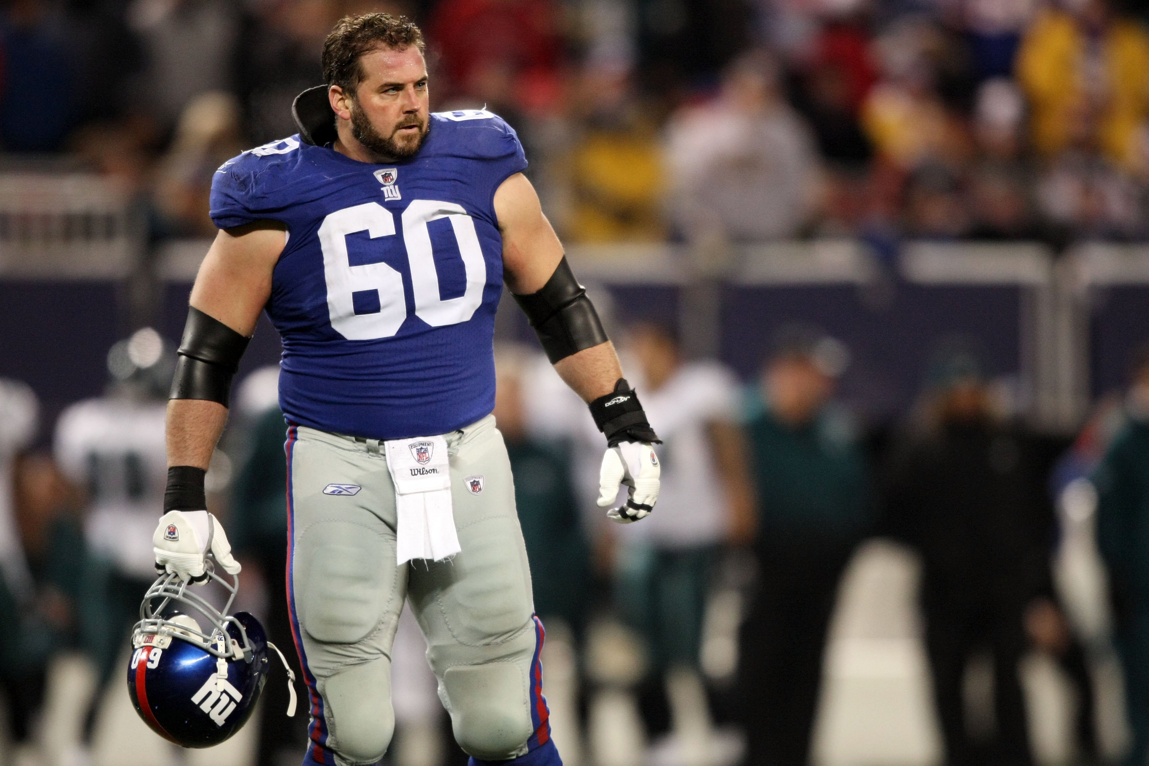 EAST RUTHERFORD, NJ - DECEMBER 13:  Shaun O'Hara #60 of the New York Giants looks on against  the Philadelphia Eagles at Giants Stadium on December 13, 2009 in East Rutherford, New Jersey.  (Photo by Nick Laham/Getty Images)