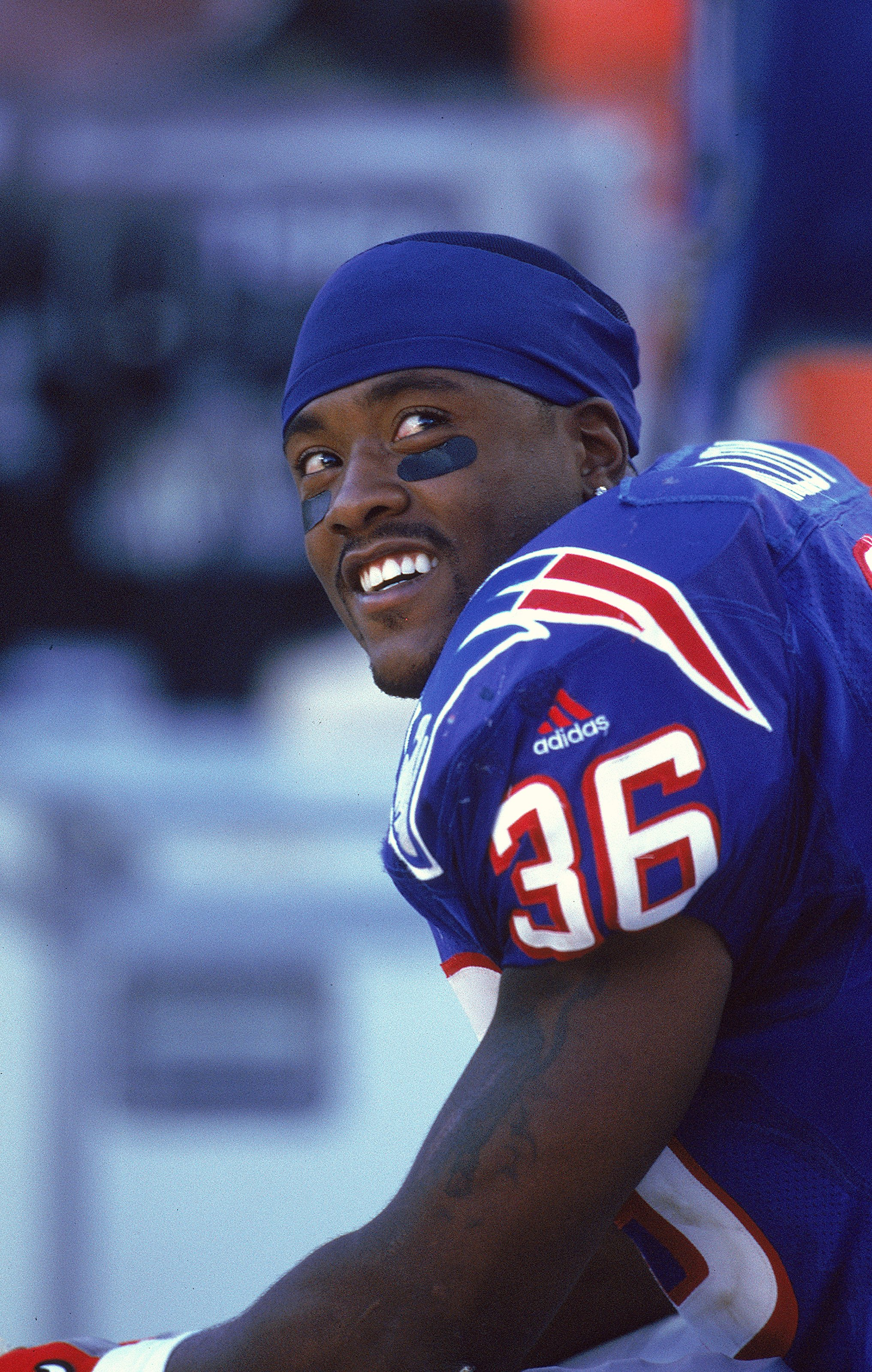 31 Oct 1999: Lawyer Milloy #36 of the New England Patriots smiles as he sits on the bench during the game against the Arizona Cardinals at the Sun Devil Stadium in Tempe, Arizona. The Patriots defeated the Cardinals 27-3. Mandatory Credit: Tom Hauck  /All