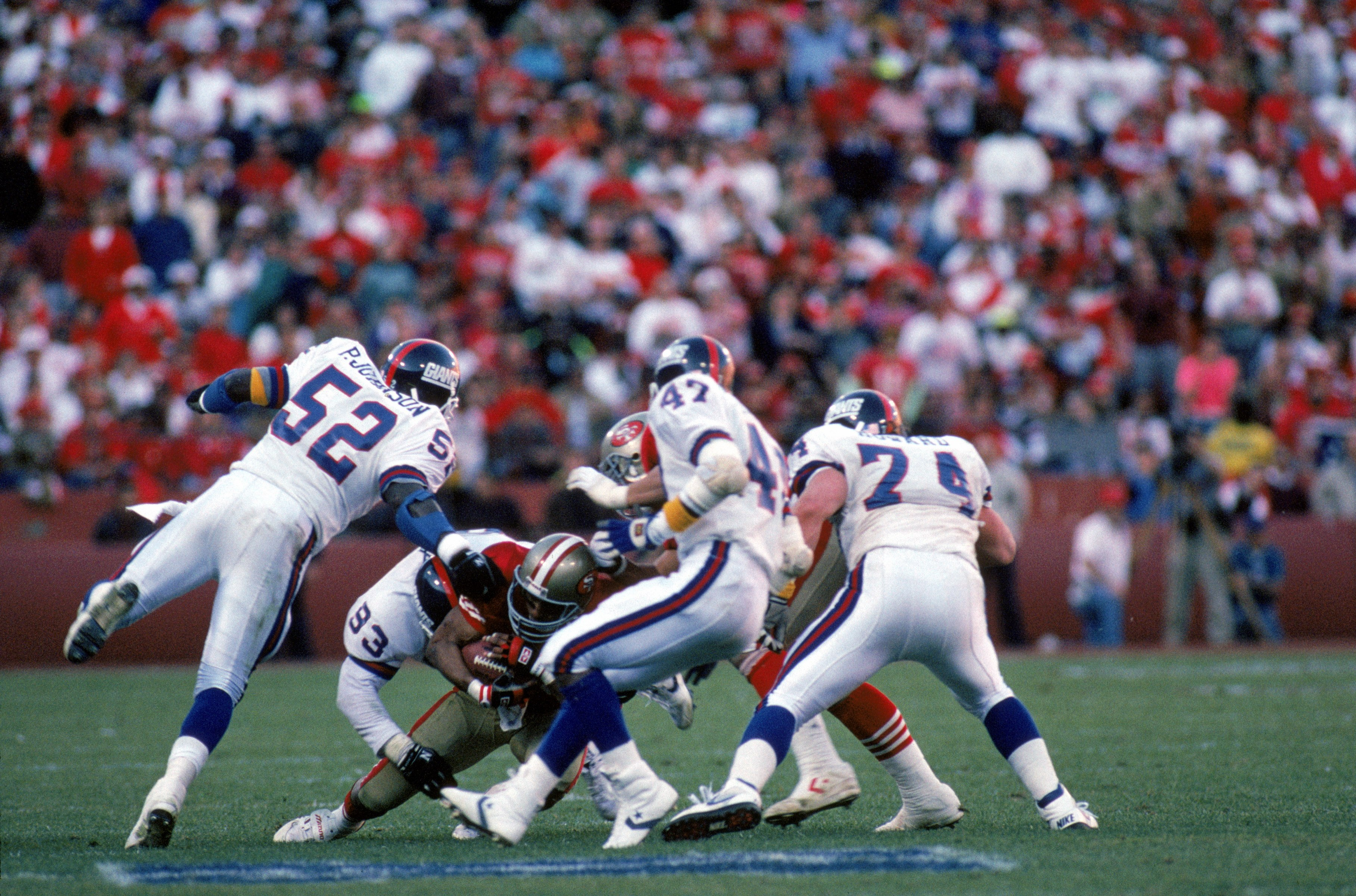 SAN FRANCISCO - JANUARY 20:  Linebacker Pepper Johnson #52, defensive end Mike Fox #93 and safety Greg Jackson #47 of the New York Giants team up to tackle San Francisco 49ers running back Roger Craig #33 during the 1990 NFC Championship Game at Candlesti