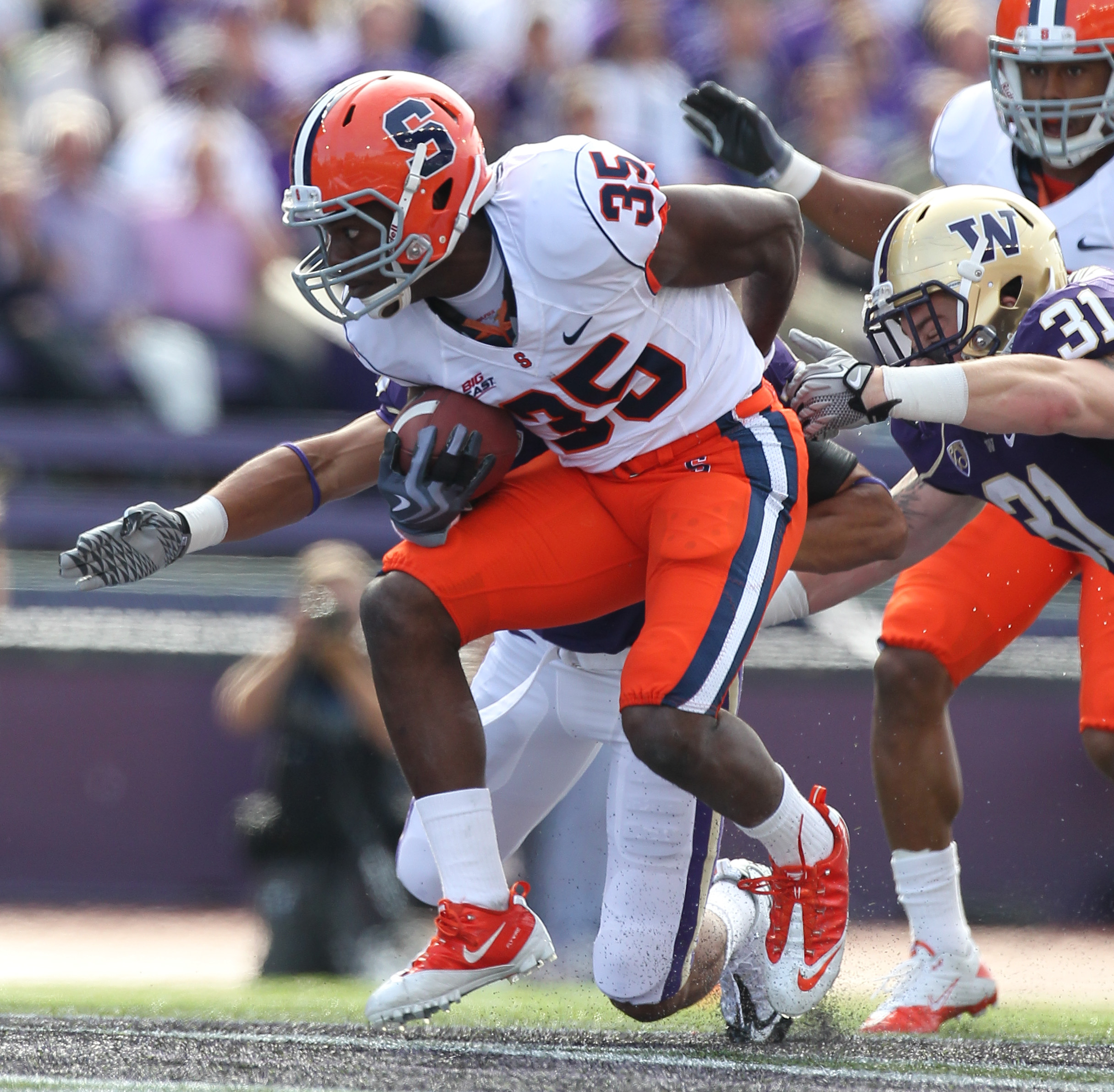 SEATTLE - SEPTEMBER 11:  Mike Holmes #35 of the Syracuse Orange rushes against Cort Dennison #31 of the Washington Huskies on September 11, 2010 at Husky Stadium in Seattle, Washington. (Photo by Otto Greule Jr/Getty Images)