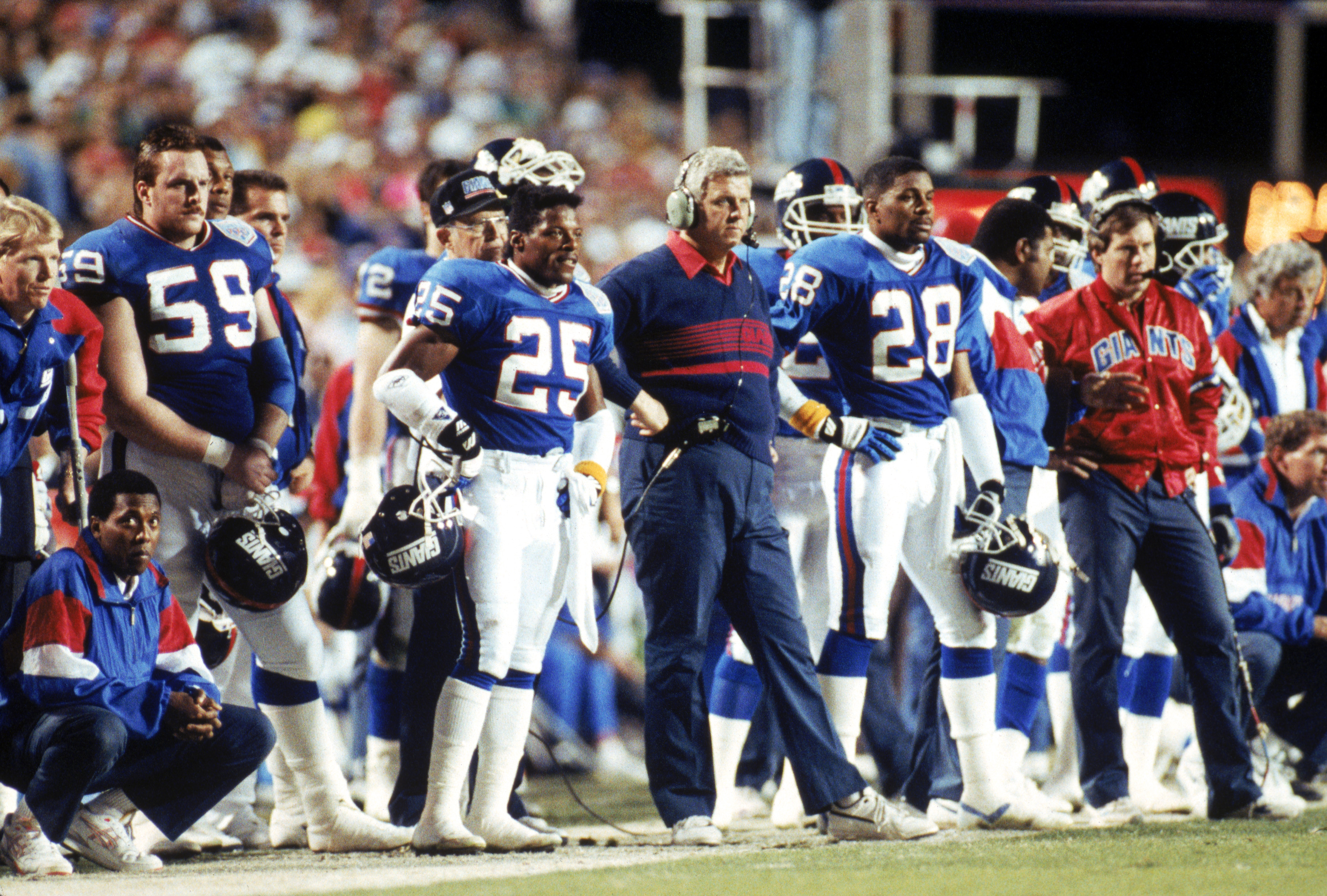 TAMPA, FL - JANUARY 27:  Cornerback Mark Collins #25, head coach Bill Parcells, cornerback Everson Walls #28 and assistant coach Bill Belichick of the New York Giants stand on the sideline against the Buffalo Bills during Super Bowl XXV at Tampa Stadium o