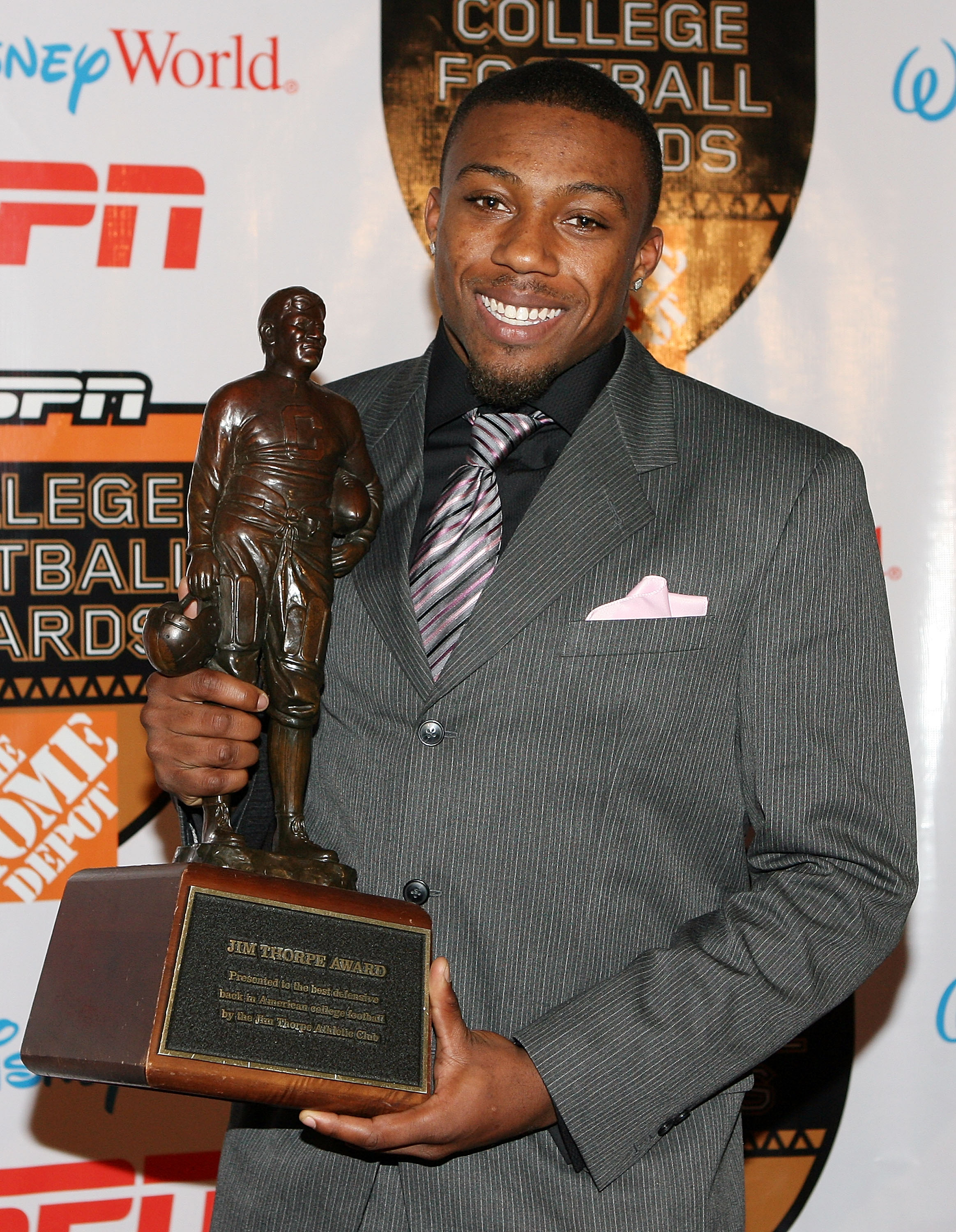 LAKE BUENA VISTA, FL - DECEMBER 10:  Defensive back Eric Berry of the Tennessee Volunteers poses with the Jim Thorpe Award trophy during the Home Depot ESPNU College Football Awards at the Disney Boardwalk on December 10, 2009 in Lake Buena Vista, Florida