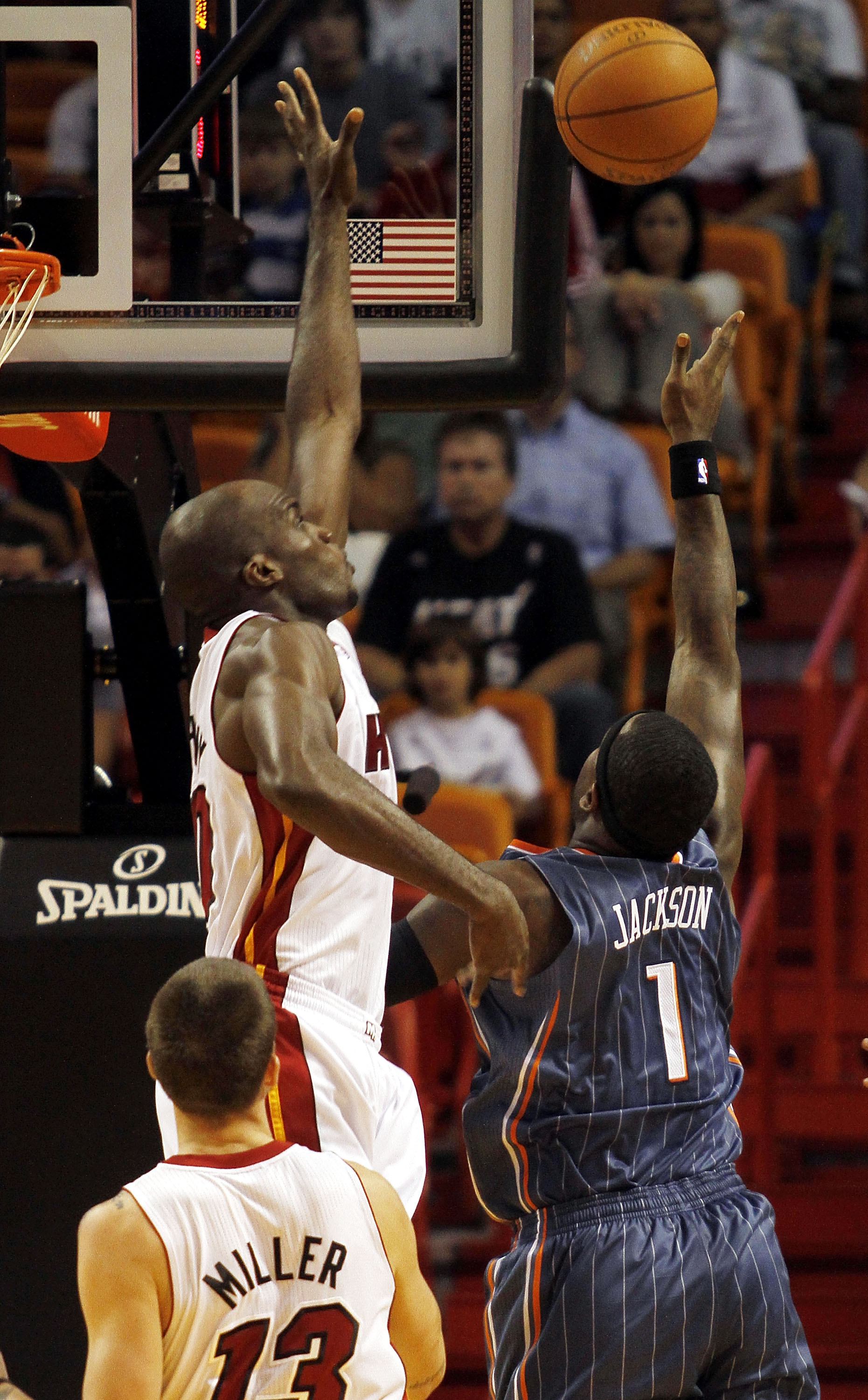 MIAMI - OCTOBER 18:  Center Joel Anthony #50 of the Miami Heat blocks a shot against Forward Stephen Jackson #1 of the Charlotte Bobcats on October 18, 2010 at American Airlines Arena in Miami, Florida. NOTE TO USER: User expressly acknowledges and agrees