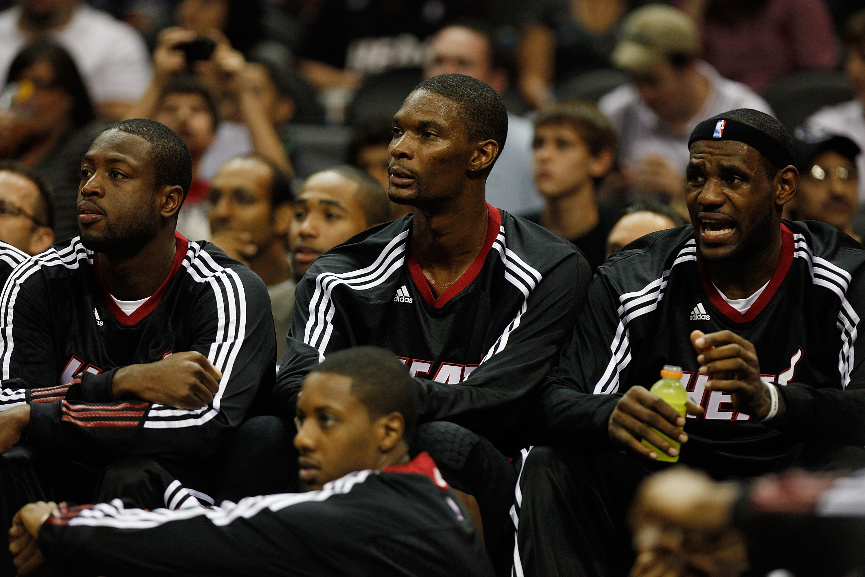 SAN ANTONIO - OCTOBER 09:  Dwayne Wade #3, Chris Bosh #1 and LeBron James #6 of the Miami Heat sit on the bench during the game against the San Antonio Spurs at the AT&T Center on October 9, 2010 in San Antonio, Texas.  NOTE TO USER: User expressly acknow