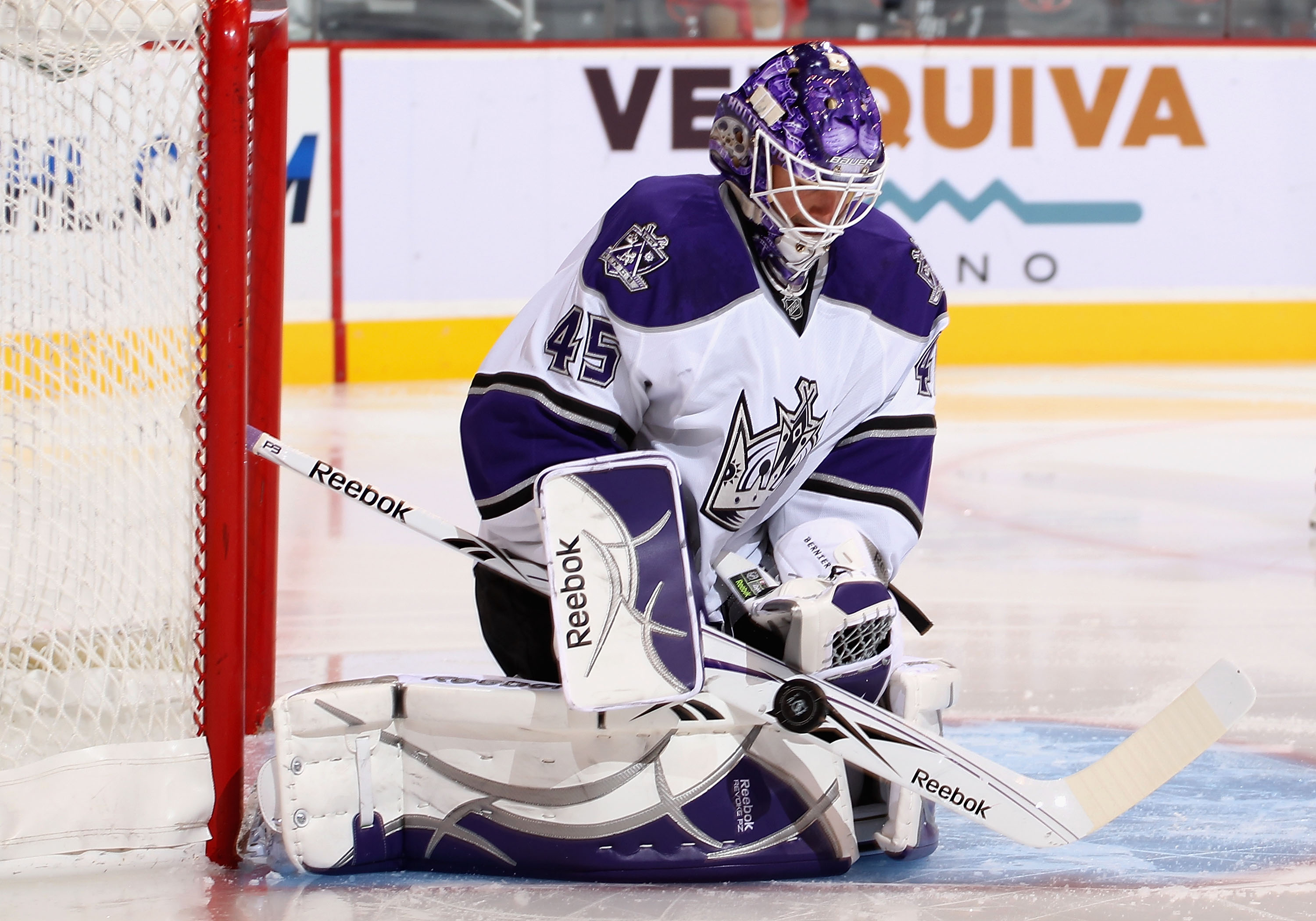 GLENDALE, AZ - SEPTEMBER 23:  Goaltender Jonathan Bernier #45 of the Los Angeles Kings makes a stick save on the shot from the Phoenix Coyotes during the preseason NHL game at Jobing.com Arena on September 23, 2010 in Glendale, Arizona. The Coyotes defeat