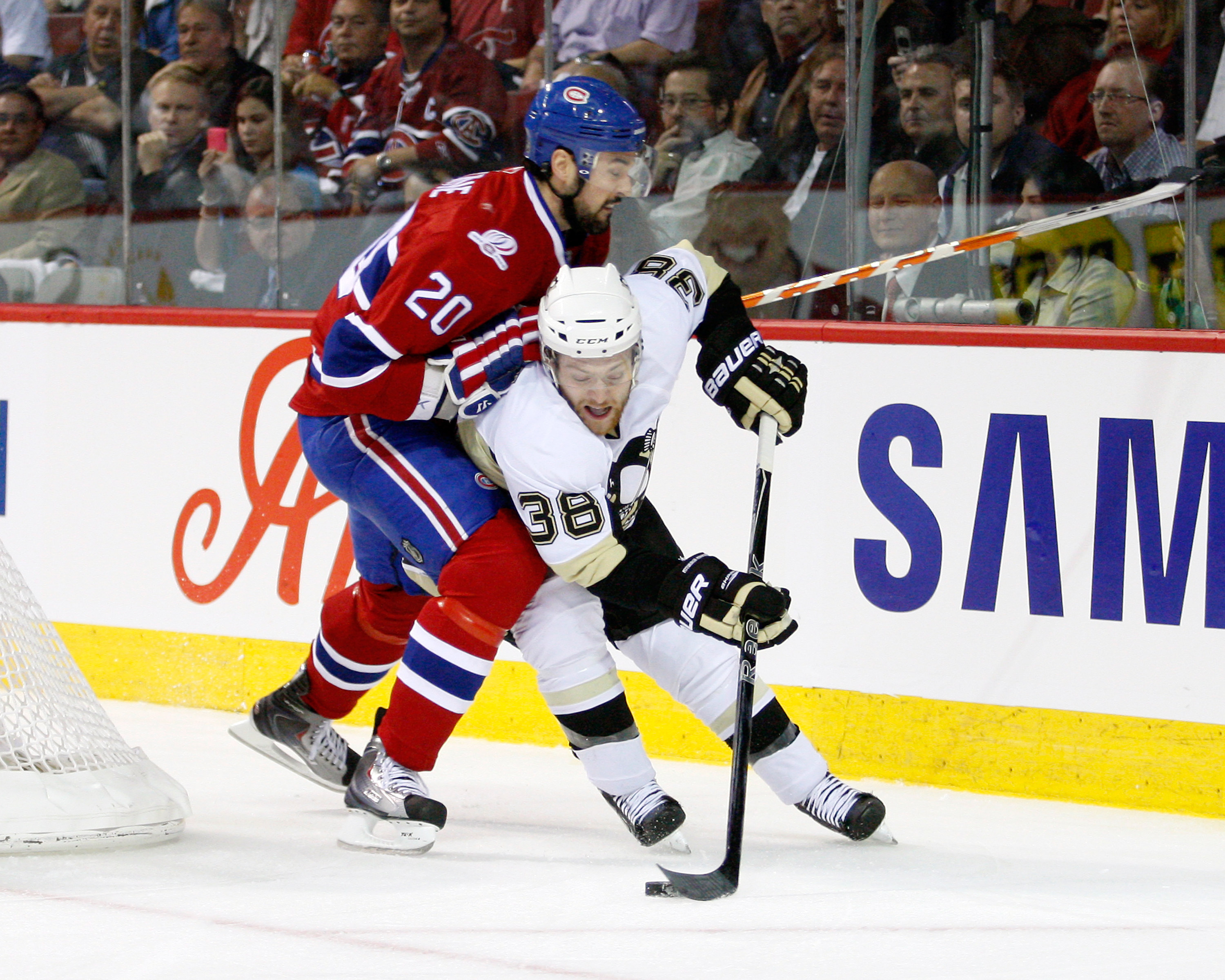 MONTREAL- MAY 4:  Mark Letestu #38 of the Pittsburgh Penguins skates with the puck while being defended by Ryan O'Byrne #20 of the Montreal Canadiens in Game Three of the Eastern Conference Semifinals during the 2010 NHL Stanley Cup Playoffs at the Bell C