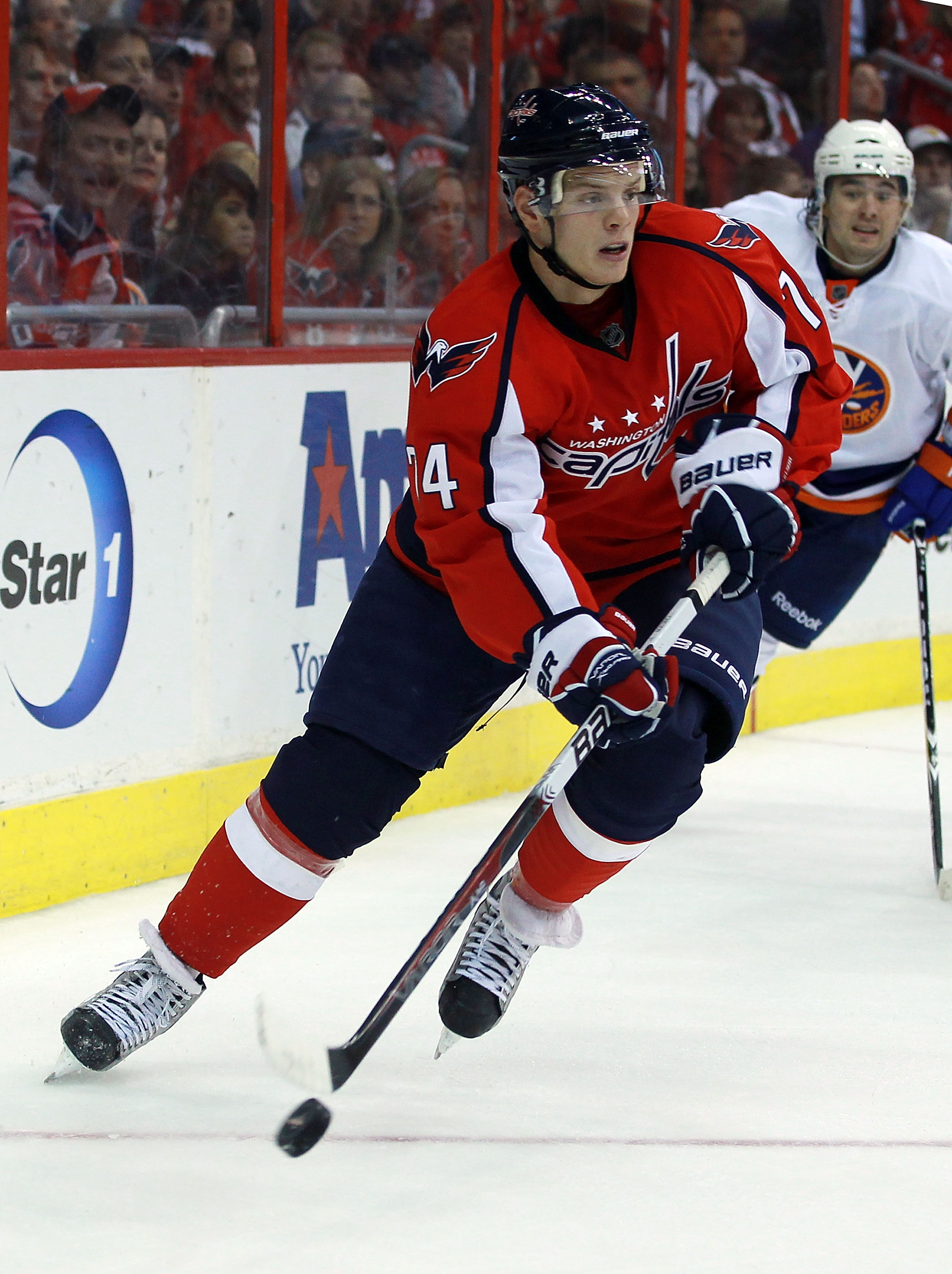 WASHINGTON - OCTOBER 13: John Carlson #74 of the Washington Capitals skates against the New York Islanders at the Verizon Center on October 13, 2010 in Washington, DC.  (Photo by Bruce Bennett/Getty Images)