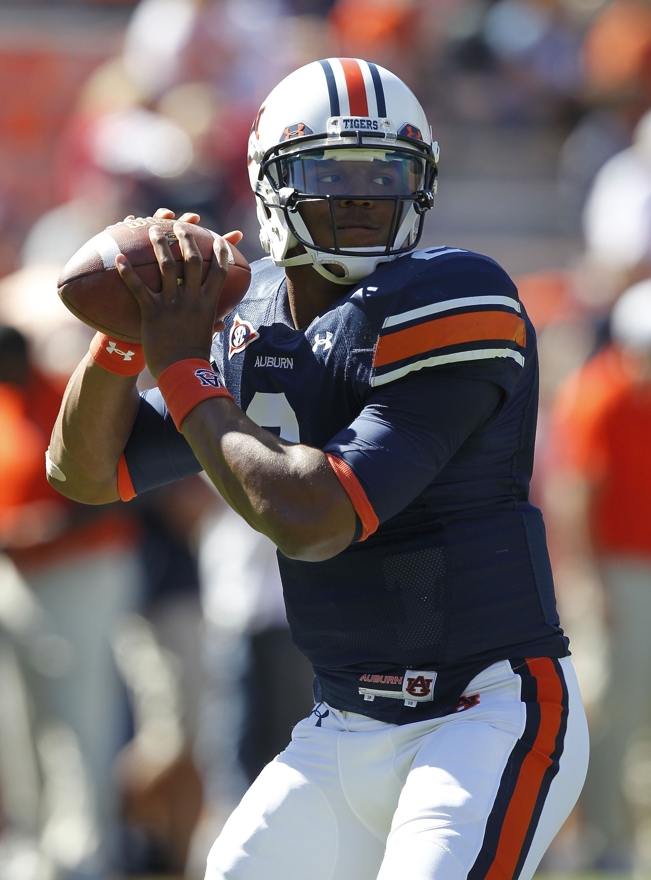 AUBURN, AL - OCTOBER 16:  Quarterback Cam Newton #2 of the Auburn Tigers drops back to throw a practice pass before the game against the Arkansas Razorbacks at Jordan-Hare Stadium on October 16, 2010 in Auburn, Alabama.  (Photo by Mike Zarrilli/Getty Imag