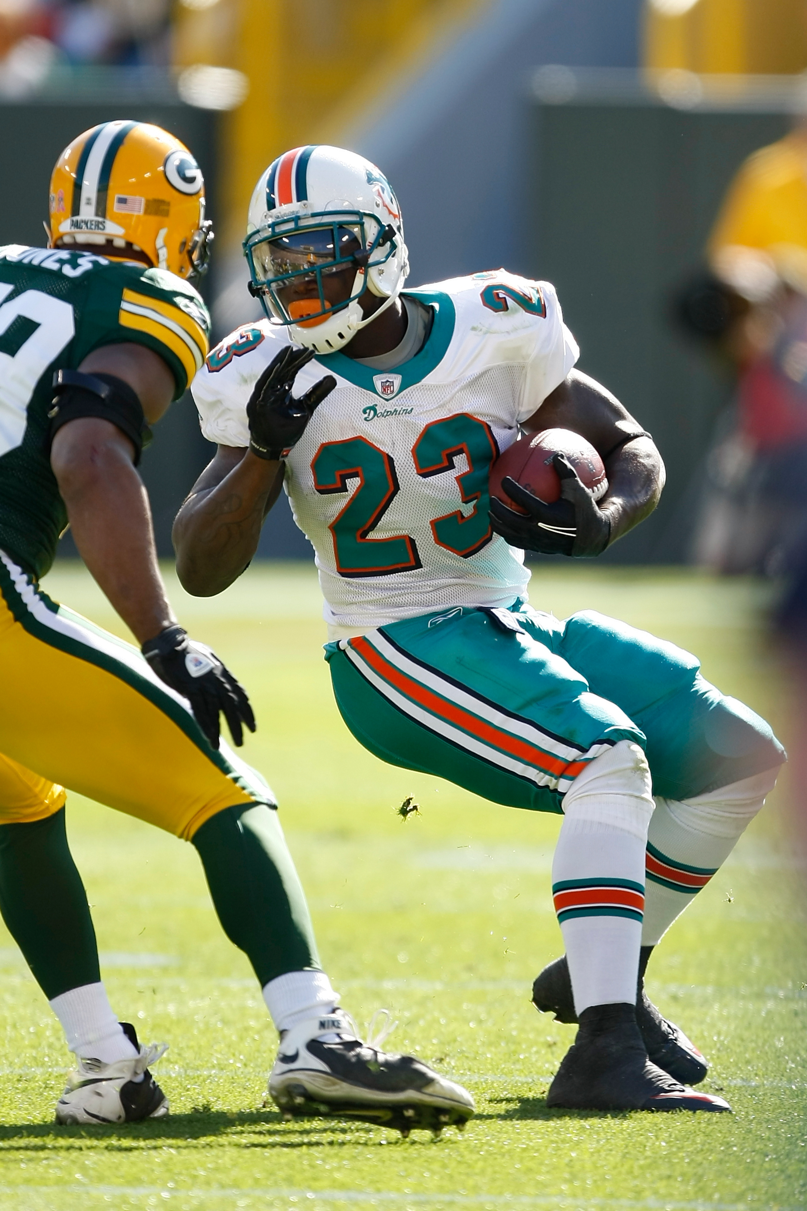 GREEN BAY, WI - OCTOBER 17: Ronnie Brown #23 of the Miami Dolphins runs against the Green Bay Packers at Lambeau Field on October 17, 2010 in Green Bay, Wisconsin. (Photo by Scott Boehm/Getty Images)