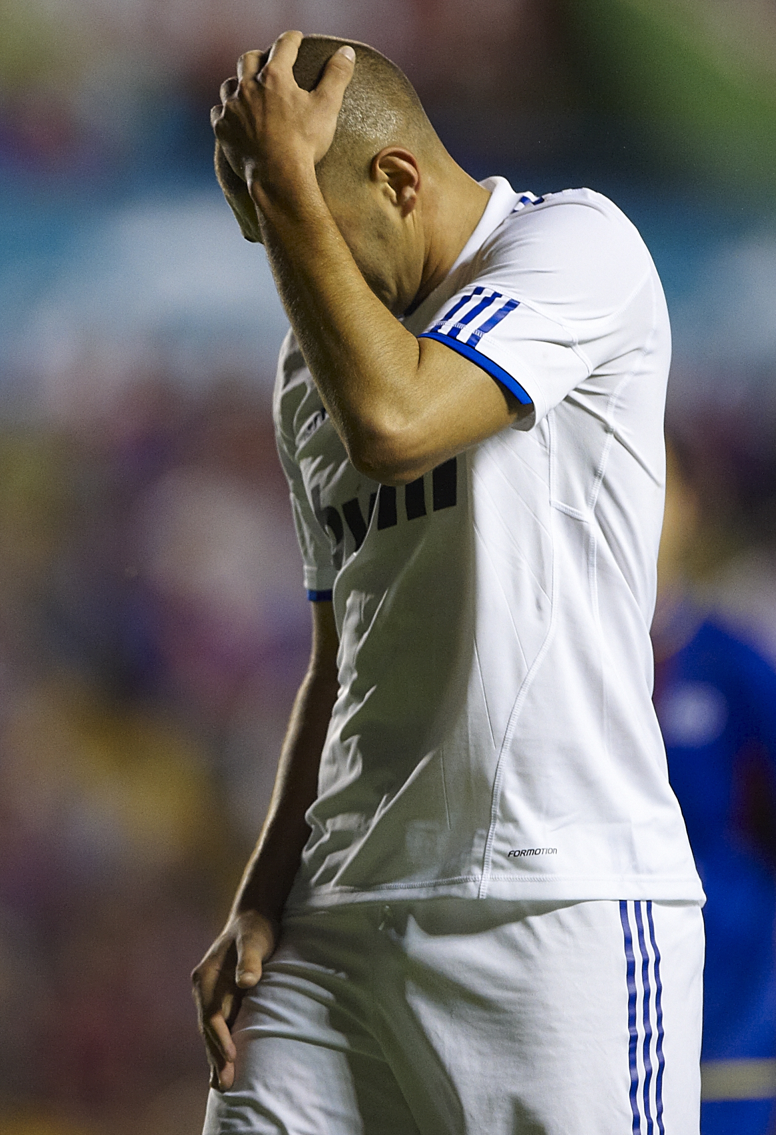 VALENCIA, SPAIN - SEPTEMBER 25:  Karim Benzema of Real Madrid reacts during the La Liga match between Levante UD and Real Madrid at Ciutat de Valencia on September 25, 2010 in Valencia, Spain.  (Photo by Manuel Queimadelos Alonso/Getty Images)