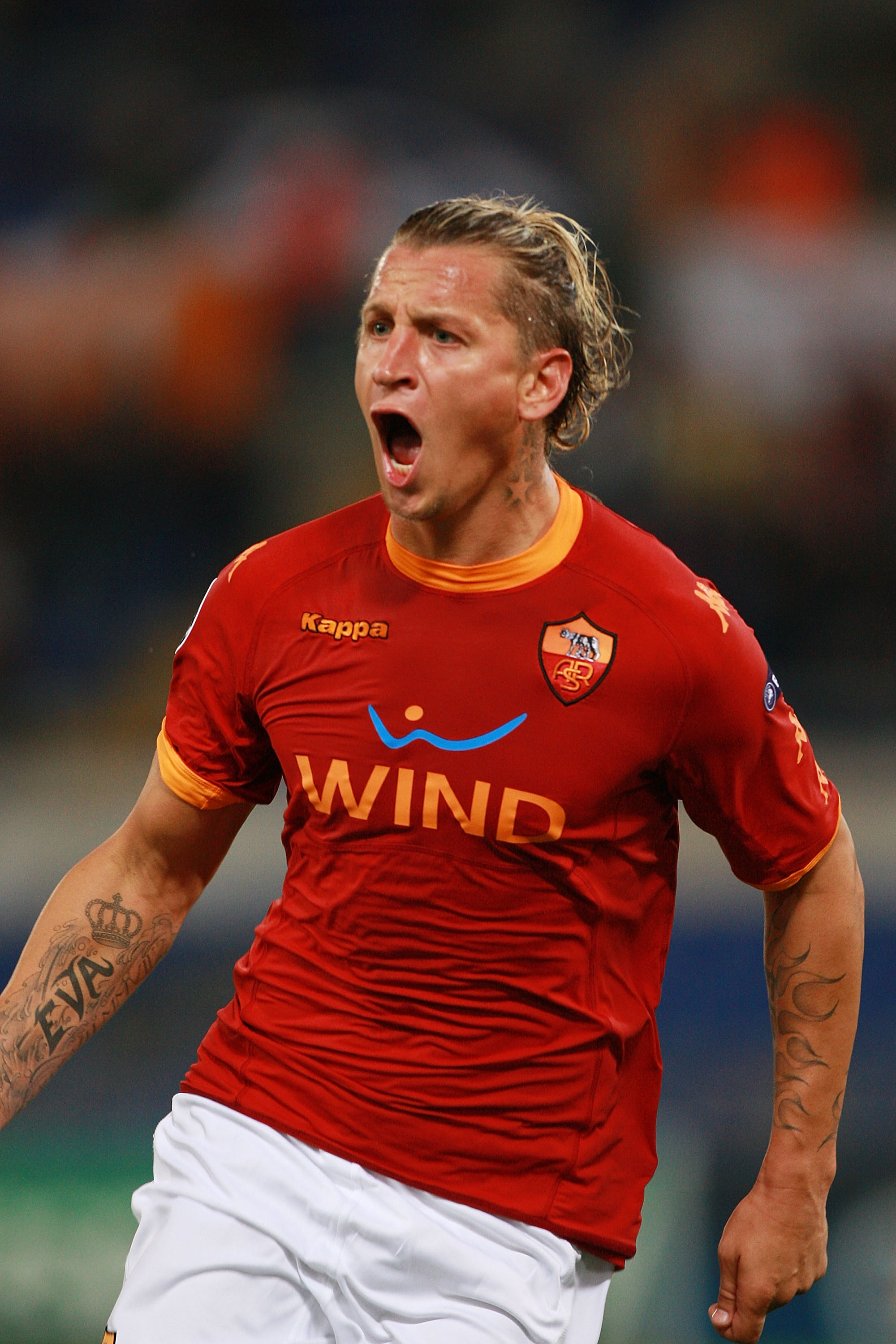 ROME - SEPTEMBER 28:  Philippe Mexes' of AS Roma celebrates after scoring the opening goal during the UEFA Champions League group E match between AS Roma and CFR Cluj at Stadio Olimpico on September 28, 2010 in Rome, Italy.  (Photo by Paolo Bruno/Getty Im