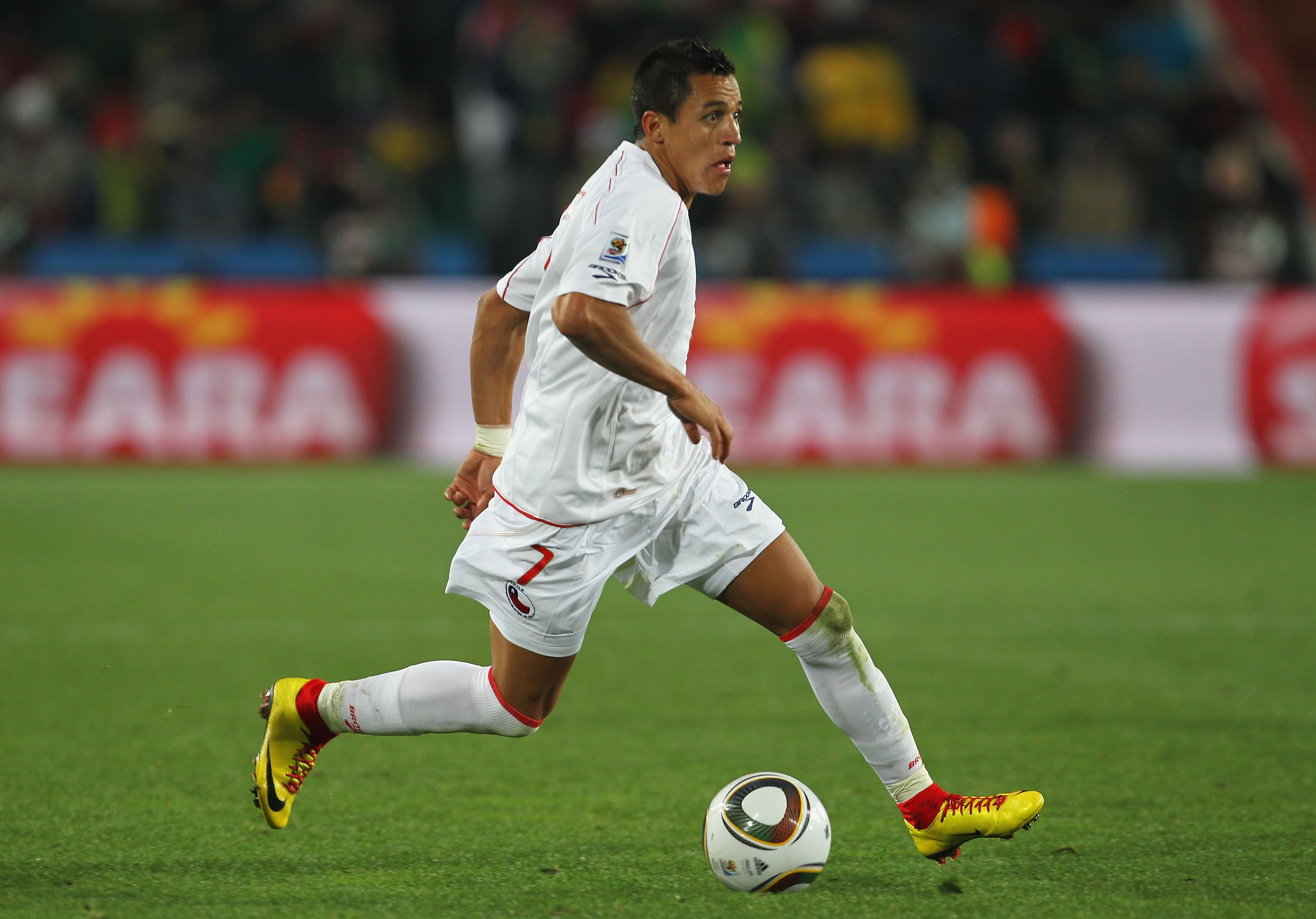 JOHANNESBURG, SOUTH AFRICA - JUNE 28:  Alexis Sanchez of Chile runs with the ball during the 2010 FIFA World Cup South Africa Round of Sixteen match between Brazil and Chile at Ellis Park Stadium on June 28, 2010 in Johannesburg, South Africa.  (Photo by