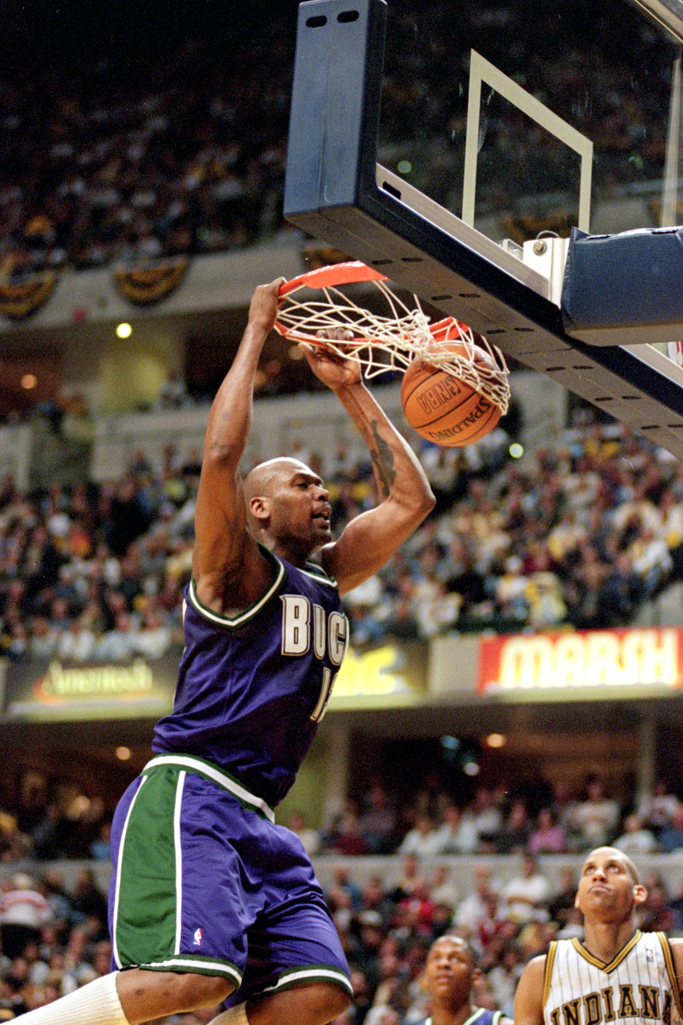 23 Apr 2000: Glenn Robinson #13 of the Milwaukee Bucks makes a slam dunk during the NBA Eastern Conference Playoffs Round One Game against the Indiana Pacers at the Conseco Fieldhouse in Indianapolis, Indiana. The Pacers defeated the Bucks 88-85..   Manda