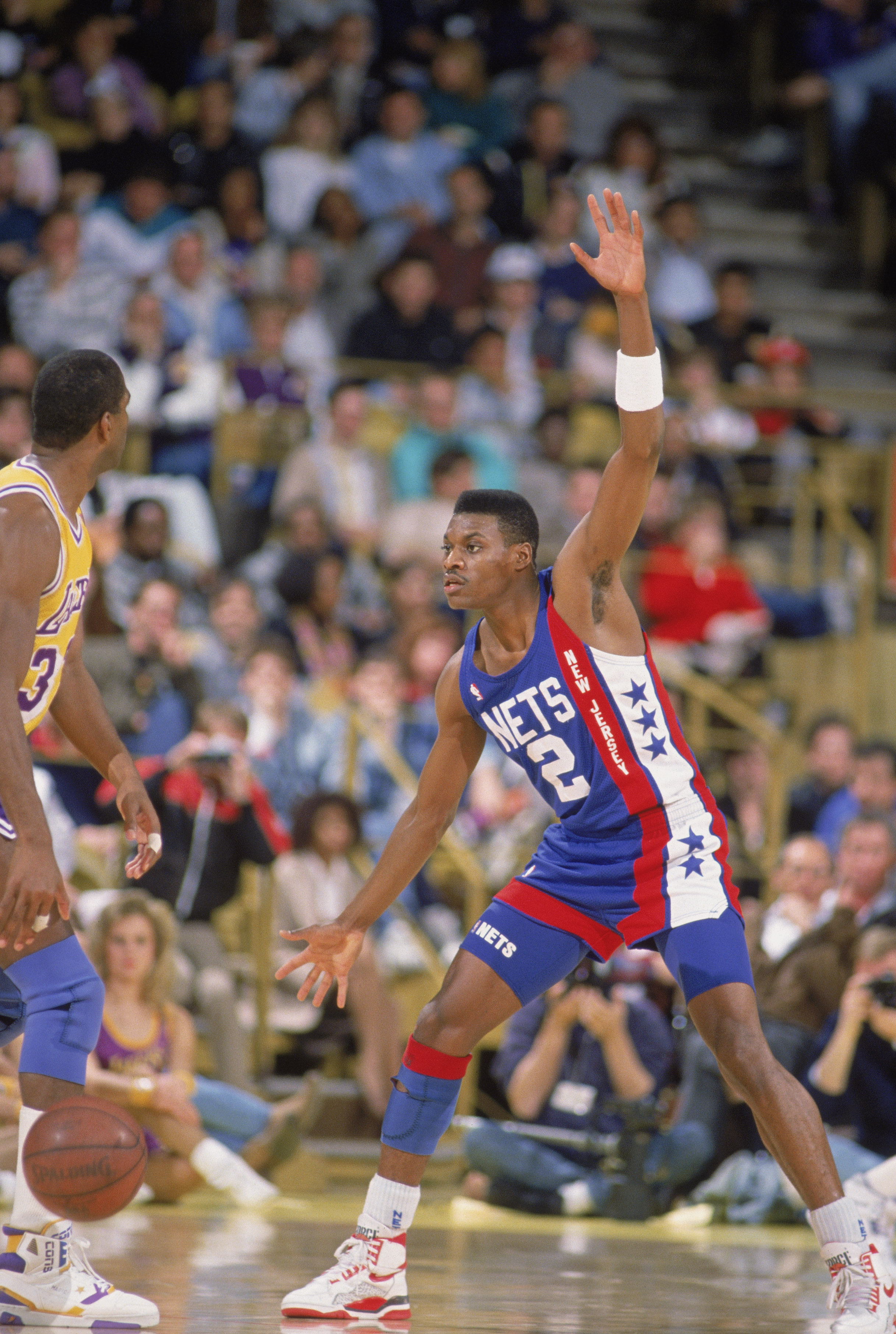 LOS ANGELES - 1990:  Dennis Hopson #2 of the New Jersey Nets defends Magic Johnson #32 of the Los Angeles Lakers during the NBA game at the Great Western Forum in Los Angeles, California in 1990. NOTE TO USER: User expressly acknowledges and agrees that,