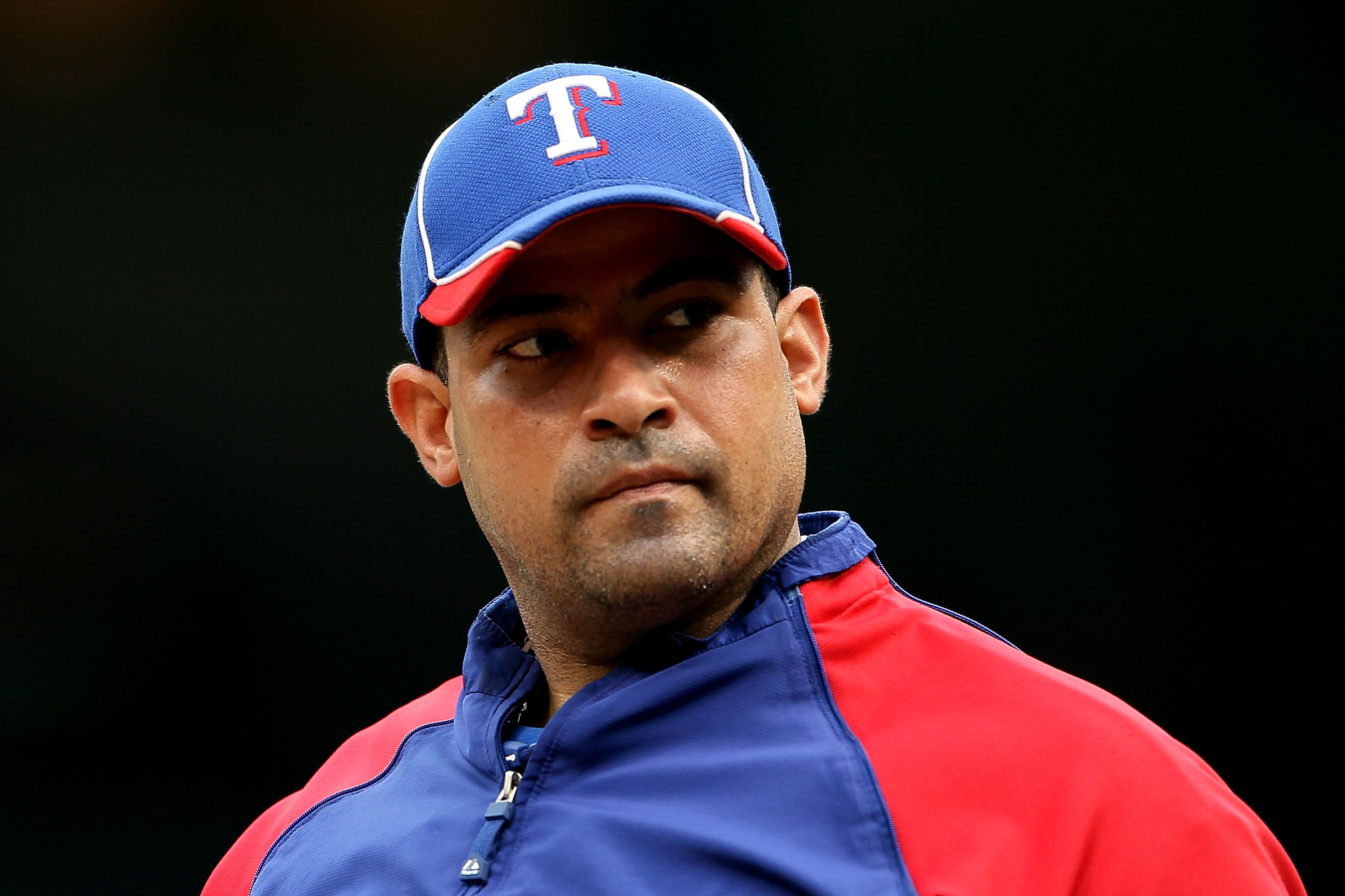 ARLINGTON, TX - OCTOBER 22:  Bengie Molina #11 of the Texas Rangers looks on during batting practice against the New York Yankees in Game Six of the ALCS during the 2010 MLB Playoffs at Rangers Ballpark in Arlington on October 22, 2010 in Arlington, Texas