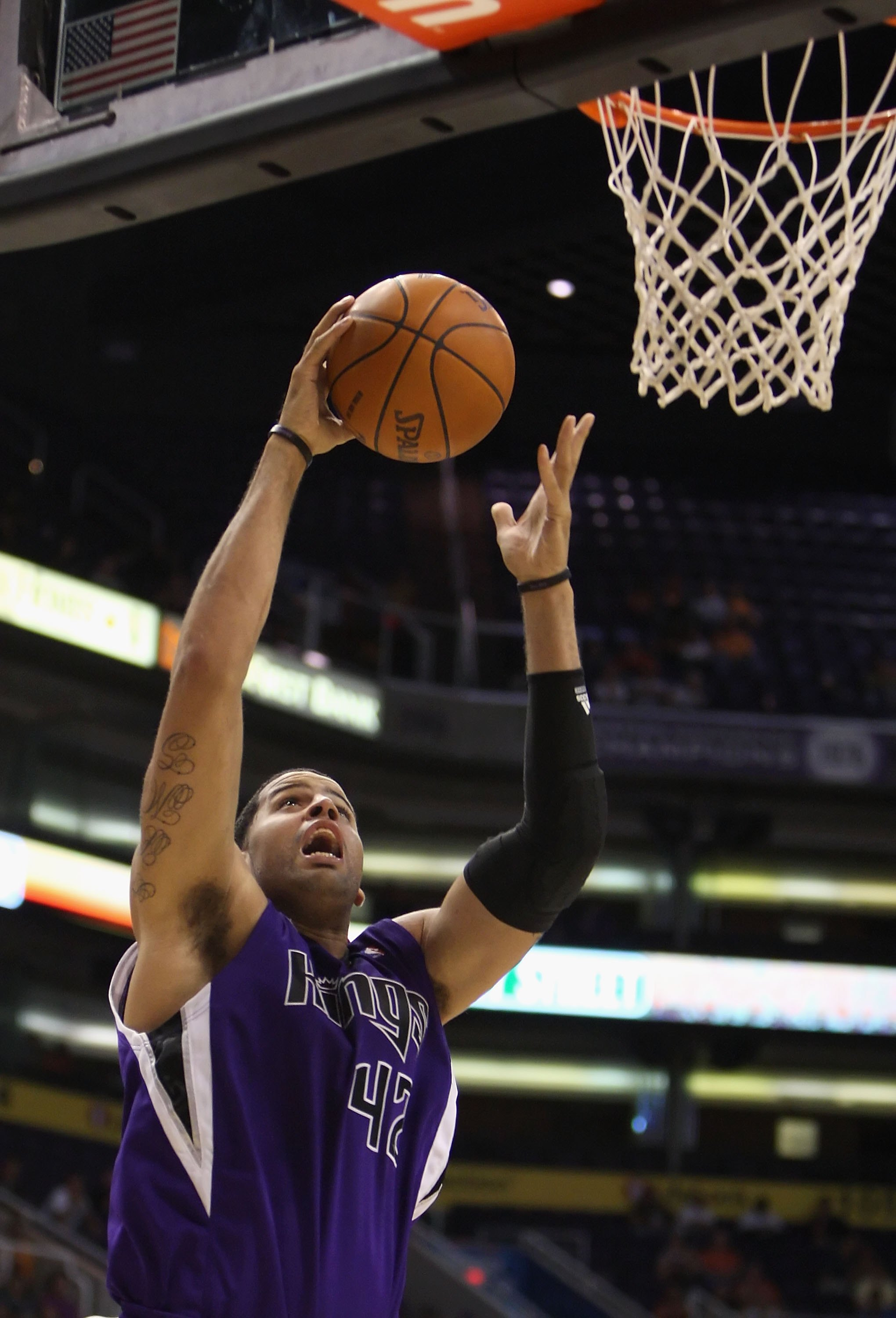 PHOENIX - OCTOBER 20:  Sean May #42 of the Sacramento Kings lays up a shot against the Phoenix Suns during the NBA preseason game at US Airways Center on October 20, 2009 in Phoenix, Arizona. The Suns defeated the Kings 143-127.  NOTE TO USER: User expres