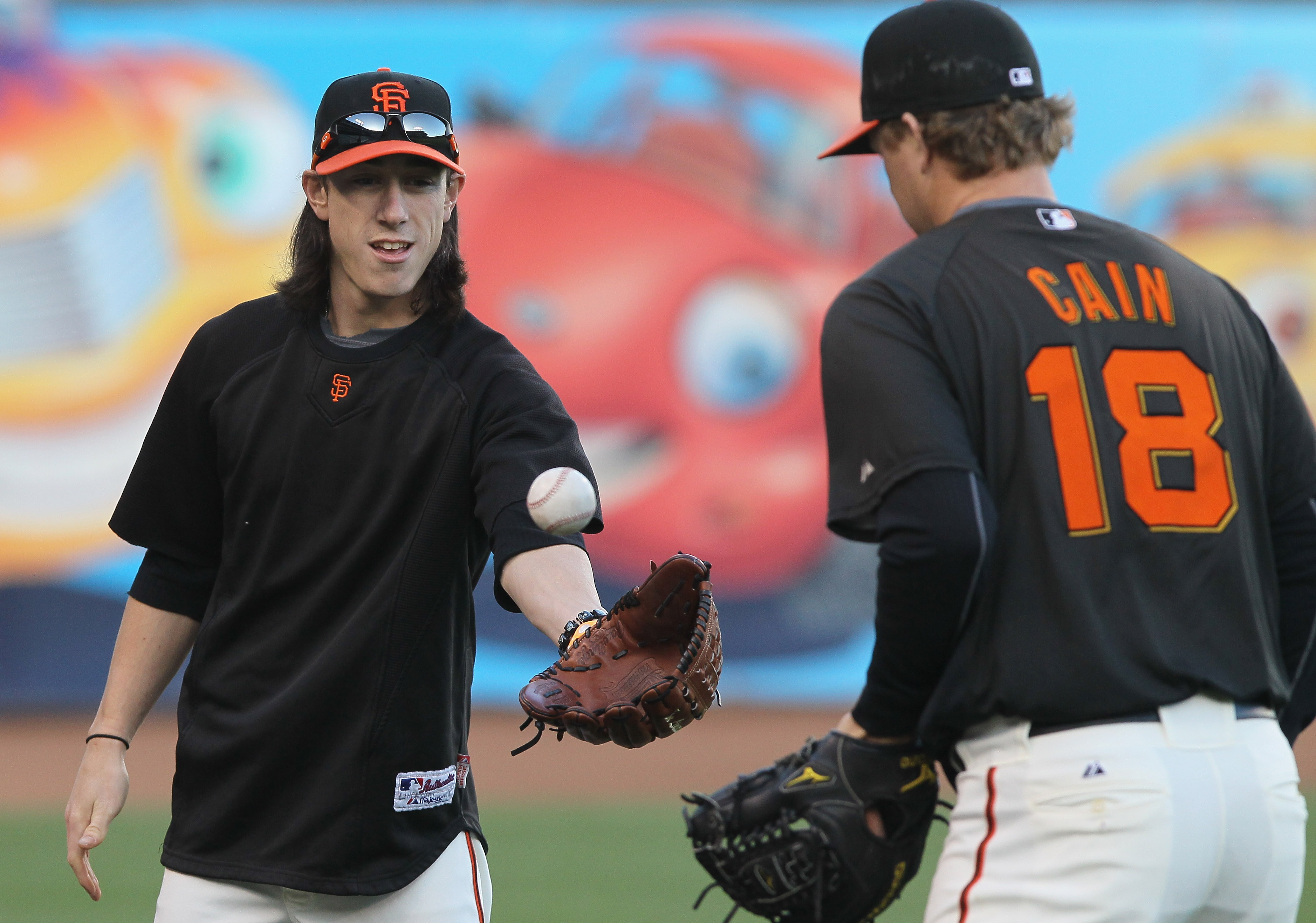 SAN FRANCISCO - OCTOBER 25:  Tim Lincecum #55 of the San Francisco Giants plays catch with teammate Matt Cain #18 during a team workout at AT&T Park on October 25, 2010 in San Francisco, California. The Giants are preparing to face the Texas Rangers in th