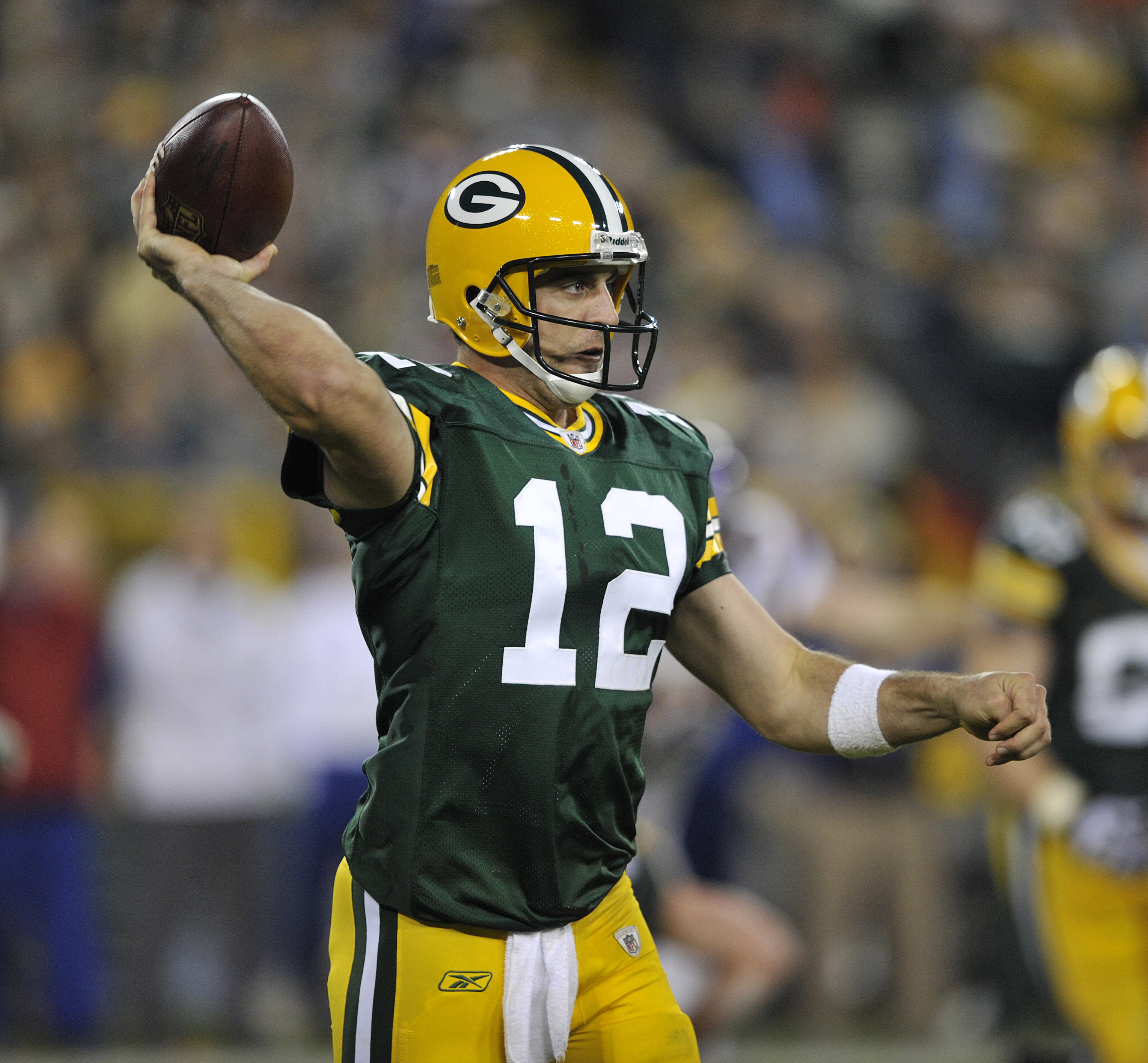 GREEN BAY, WI - OCTOBER 24:   Aaron Rodgers #12 of the Green Bay Packers passes against the Minnesota Vikings at Lambeau Field on October 24, 2010 in Green Bay, Wisconsin. (Photo by Jim Prisching/Getty Images)