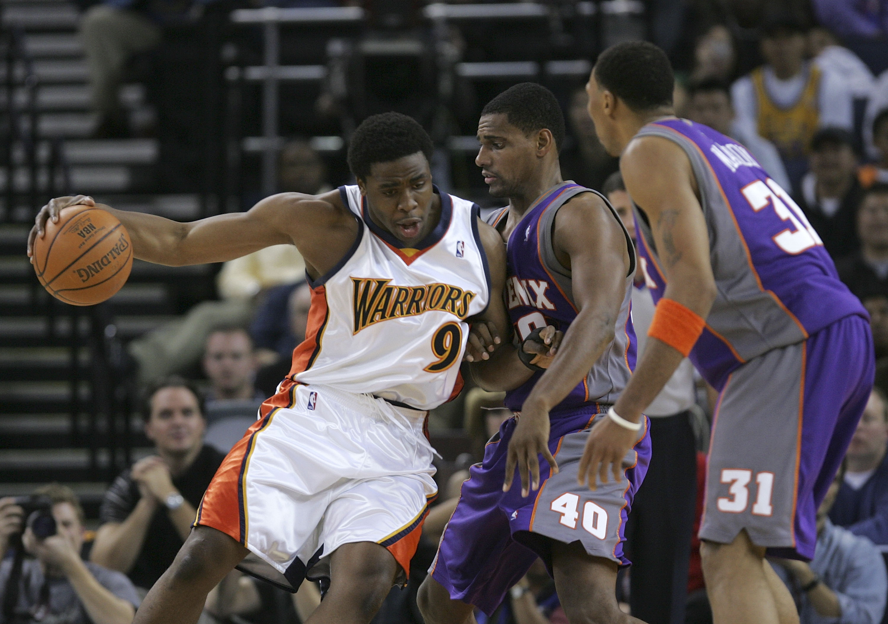 OAKLAND, CA - DECEMBER 07:  Ike Diogu #9 of the Golden State Warriors drives the ball as Kurt Thomas #40 and Shawn Marion #31 of the Phoenix Suns defend on December 7, 2005 at the Arena in Oakland, California. NOTE TO USER: User expressly acknowledges and