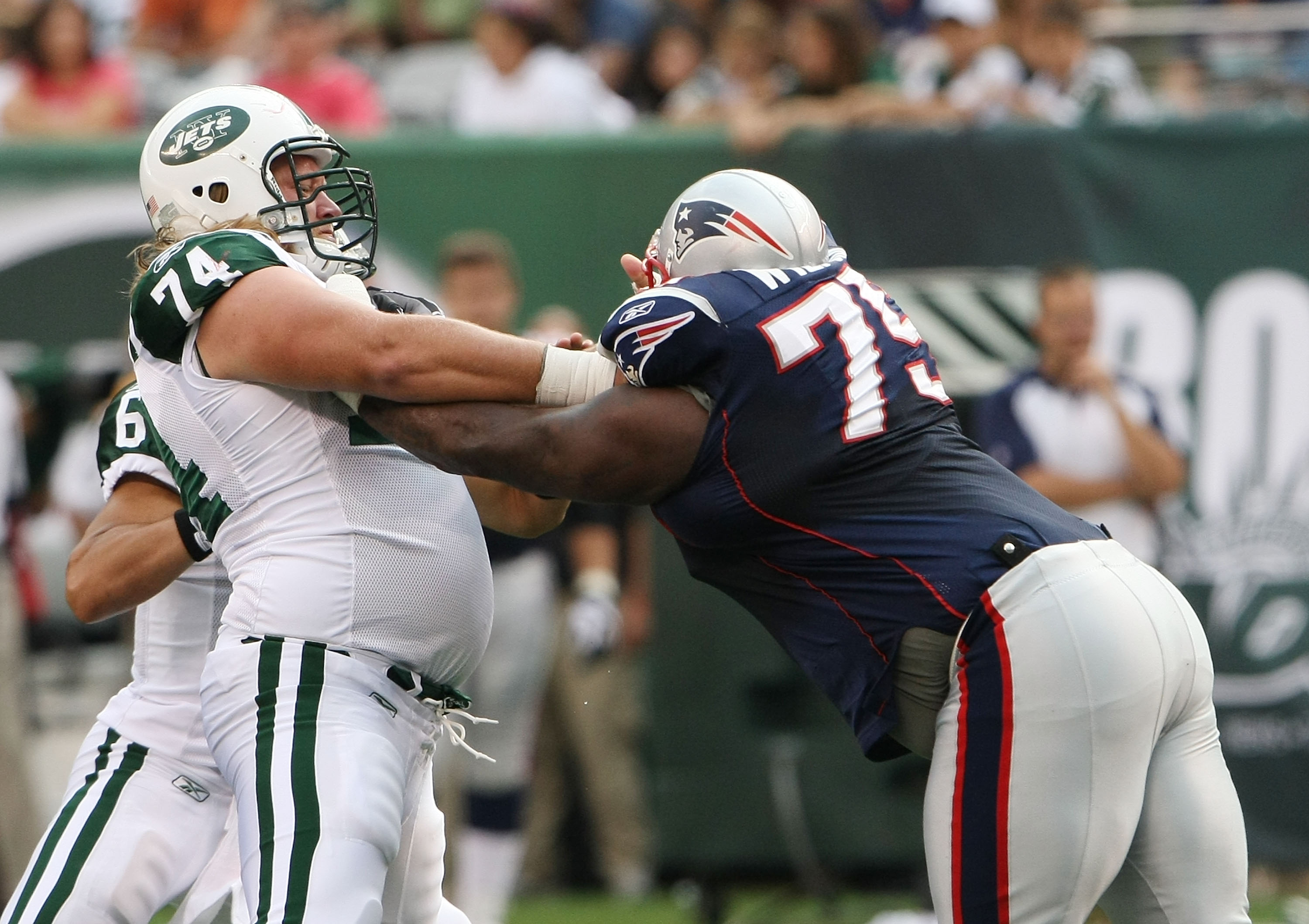 EAST RUTHERFORD, NJ - SEPTEMBER 19:  Nick Mangold #74 of the New York Jets blocks Vince Wilfork #74 of the New England Patriots during their  game on September 19, 2010 at the New Meadowlands Stadium  in East Rutherford, New Jersey.  (Photo by Al Bello/Ge