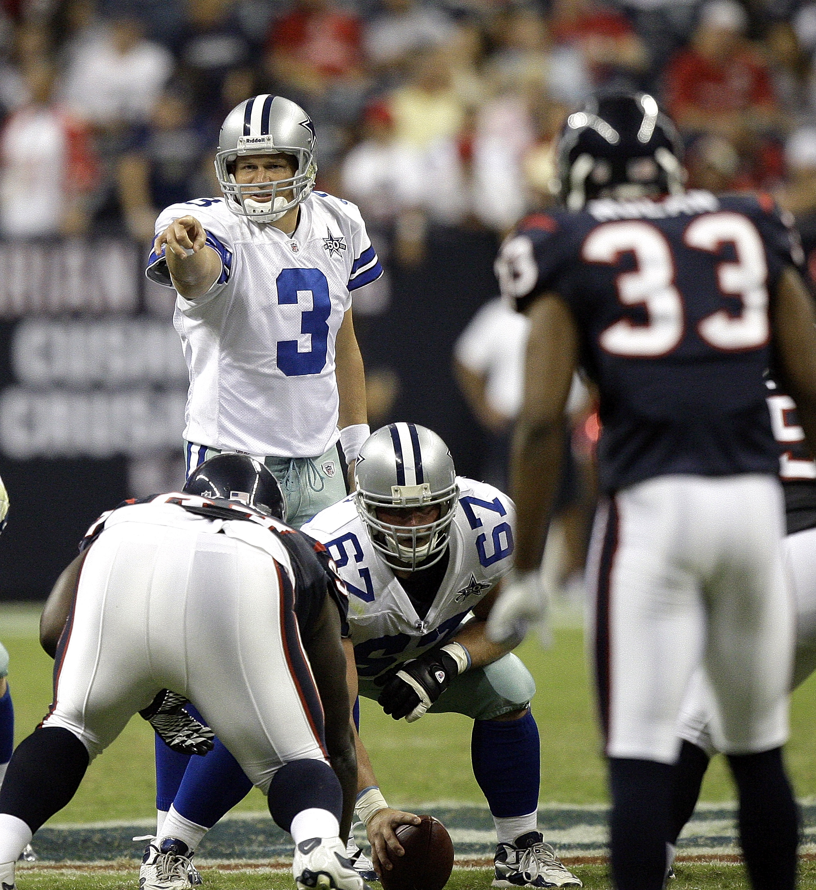 HOUSTON - AUGUST 28: Quarterback Jon Kitna #3 of the Dallas Cowboys makes an adjustment on the play during a football game against the Houston Texans as he waits for center Phil Costa #67 to hike the ball at Reliant Stadium on August 28, 2010 in Houston,