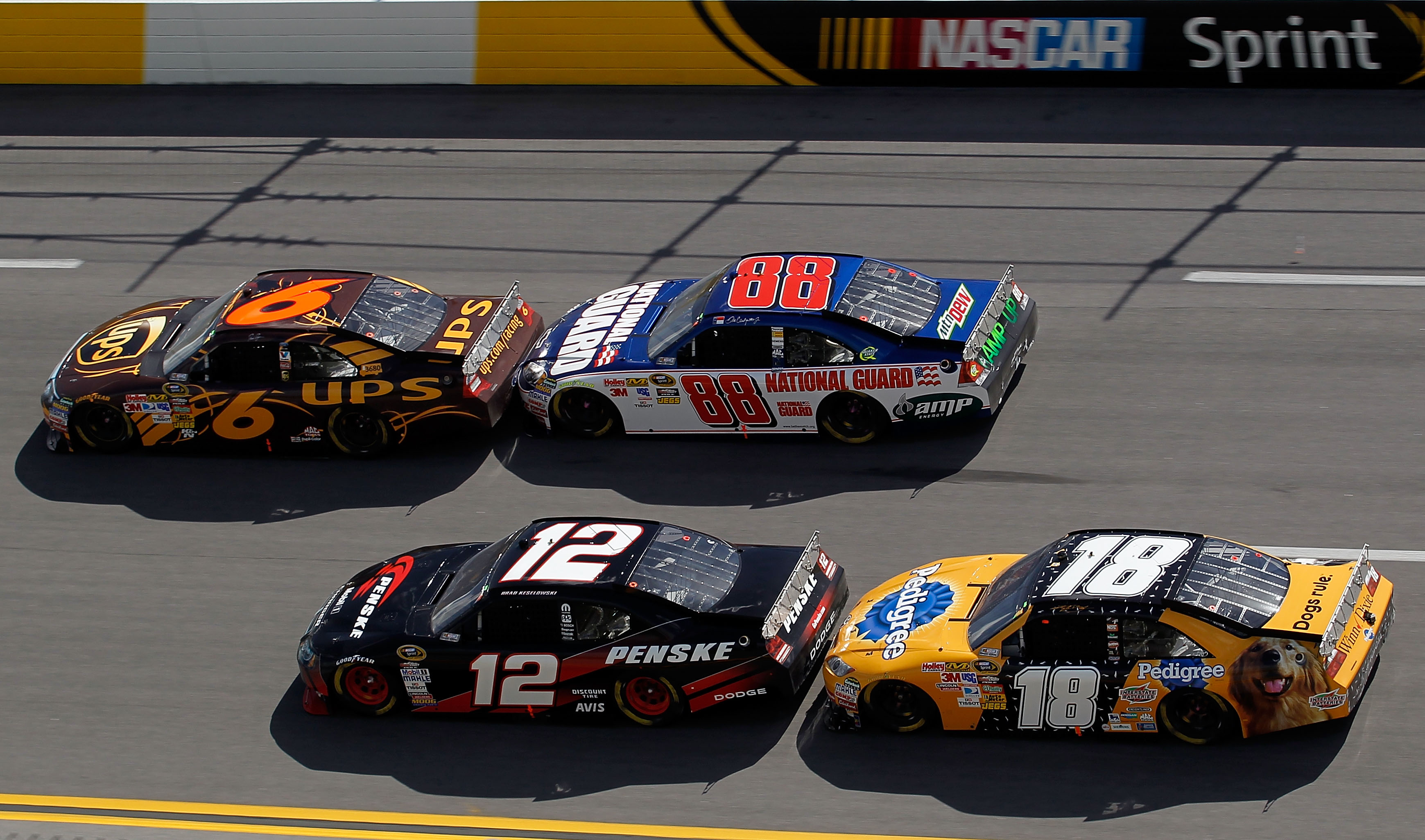 TALLADEGA, AL - APRIL 25:  Brad Keselowski, driver of the #12 Penske Dodge, and David Ragan, driver of the #6 UPS Ford, get bump drafted by Kyle Busch, driver of the #18 Pedigree Toyota, and Dale Earnhardt Jr., driver of the #88 National Guard/AMP Energy
