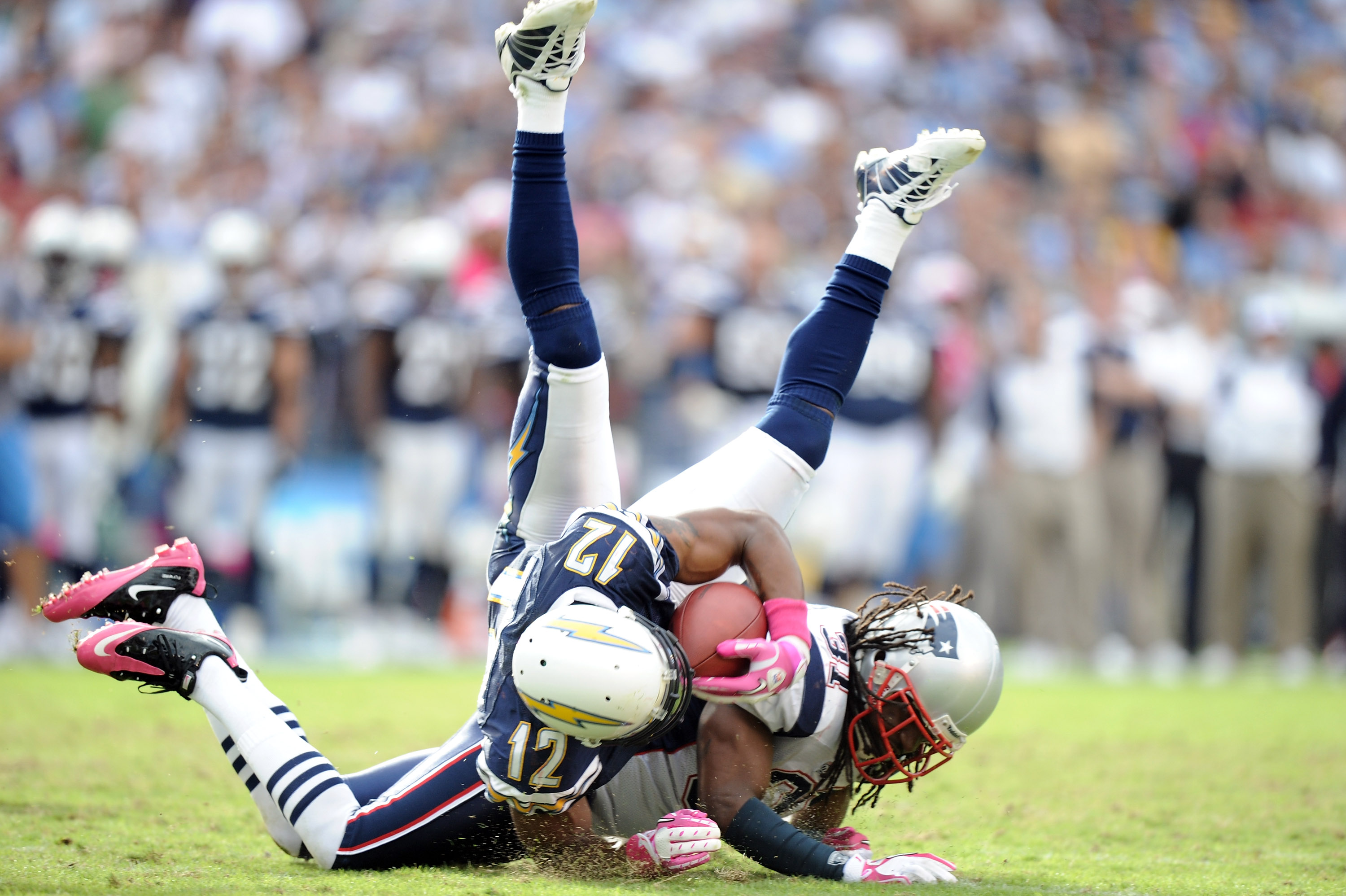 SAN DIEGO - OCTOBER 24:  Brandon Meriweather #31 of the New England Patriots up ends Patrick Crayton #12 of the San Diego Chargers during the fourth quarter at Qualcomm Stadium on October 24, 2010 in San Diego, California.  (Photo by Harry How/Getty Image