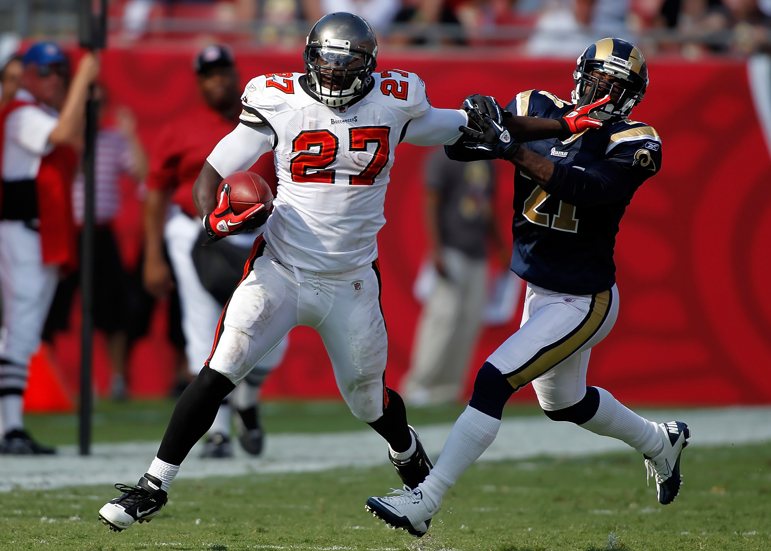TAMPA, FL - OCTOBER 24:  Running back LeGarrette Blount #27 of the Tampa Bay Buccaneers straight arms safety Oshiomogho Atogwe #21 of the St. Louis Rams during the game at Raymond James Stadium on October 24, 2010 in Tampa, Florida.  (Photo by J. Meric/Ge