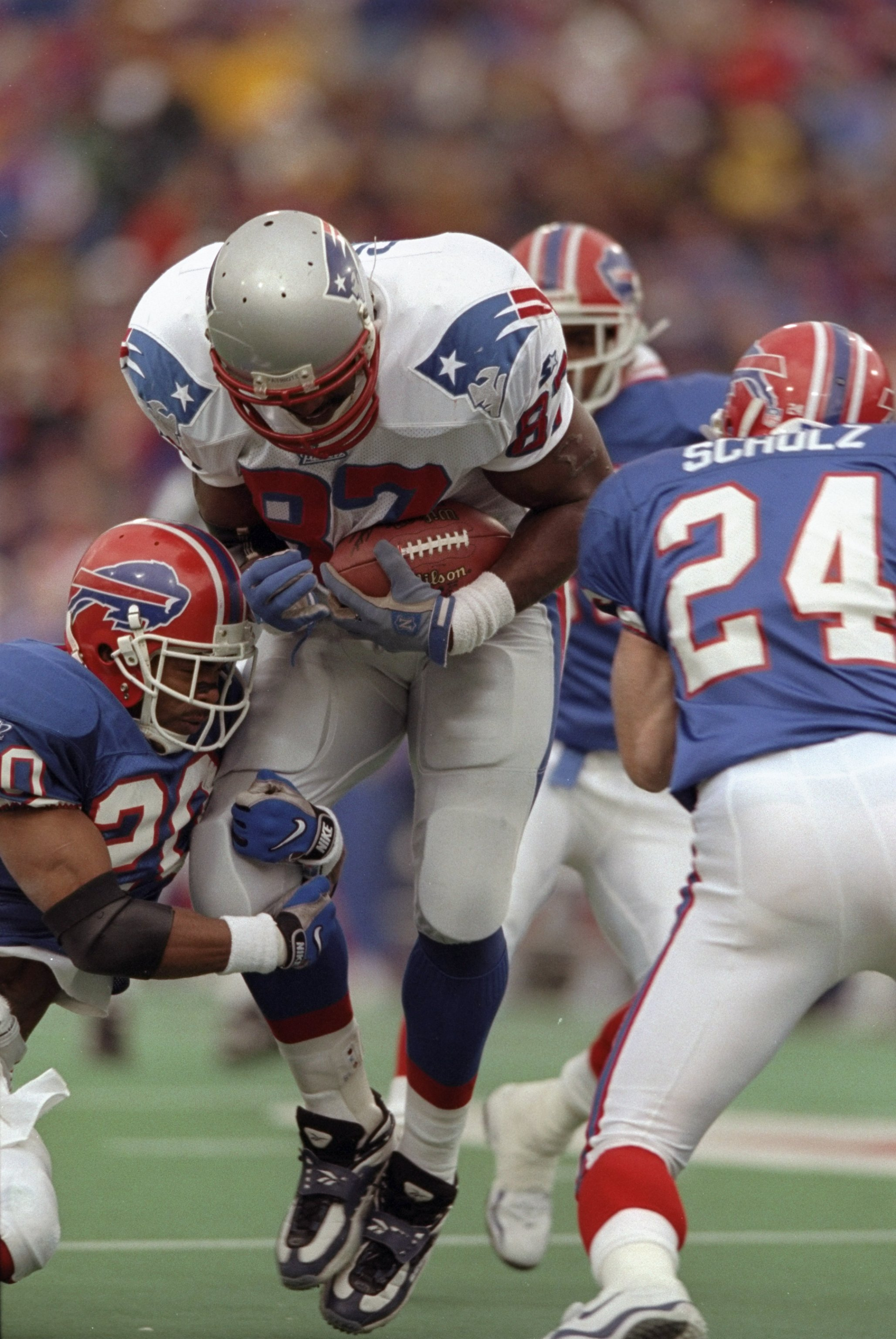 15 Nov 1998:  Tight end Ben Coates #87 of the New England Patriots is tackled by Henry Jones #20 and Kurt Schulz #24 of the Buffalo Bills during a game at the Rich Stadium in Orchard Park, New York. The Bills defeated the Patriots 13-10. Mandatory Credit:
