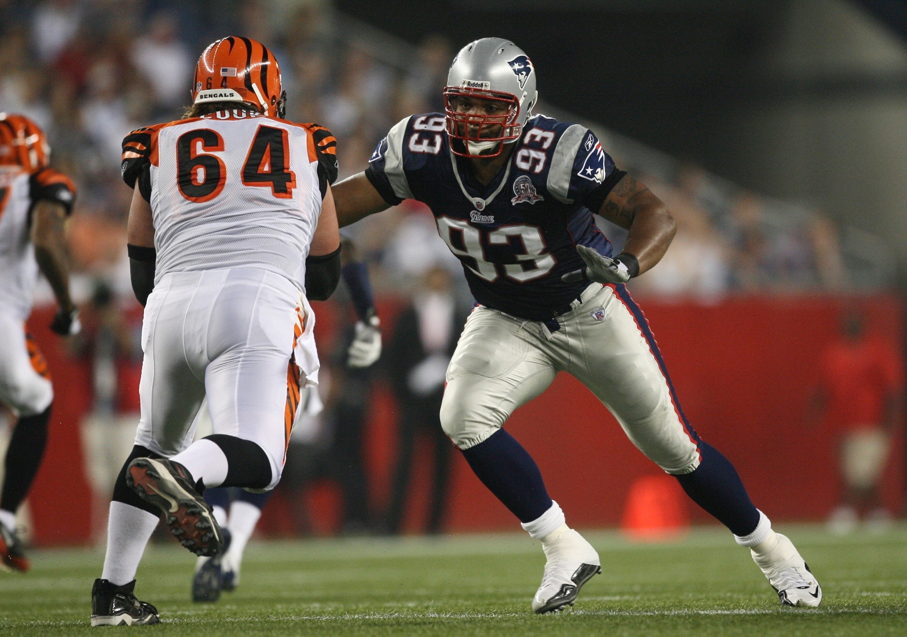 FOXBORO, MA - AUGUST 20:  Richard Seymour #93 of the New England Patriots rushes the quarterback against Kyle Cook #64 of the Cincinnati Bengals during their preseason game at Gillette Stadium on August 20, 2009 in Foxboro, Massachusetts.  (Photo by Jim R