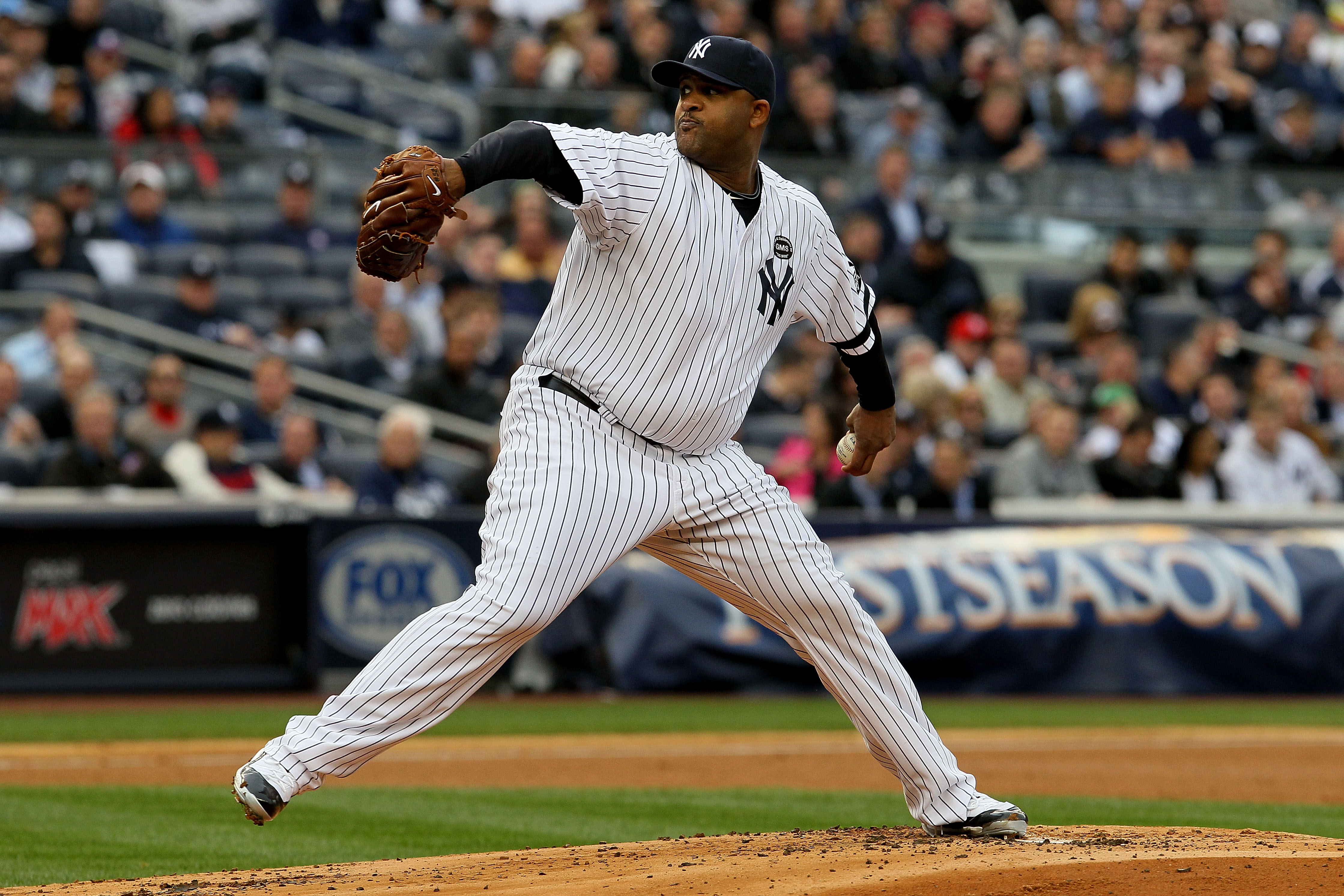 NEW YORK - OCTOBER 20:  CC Sabathia #52 of the New York Yankees pitches against the Texas Rangers in Game Five of the ALCS during the 2010 MLB Playoffs at Yankee Stadium on October 20, 2010 in the Bronx borough of New York City.  (Photo by Jim McIsaac/Get