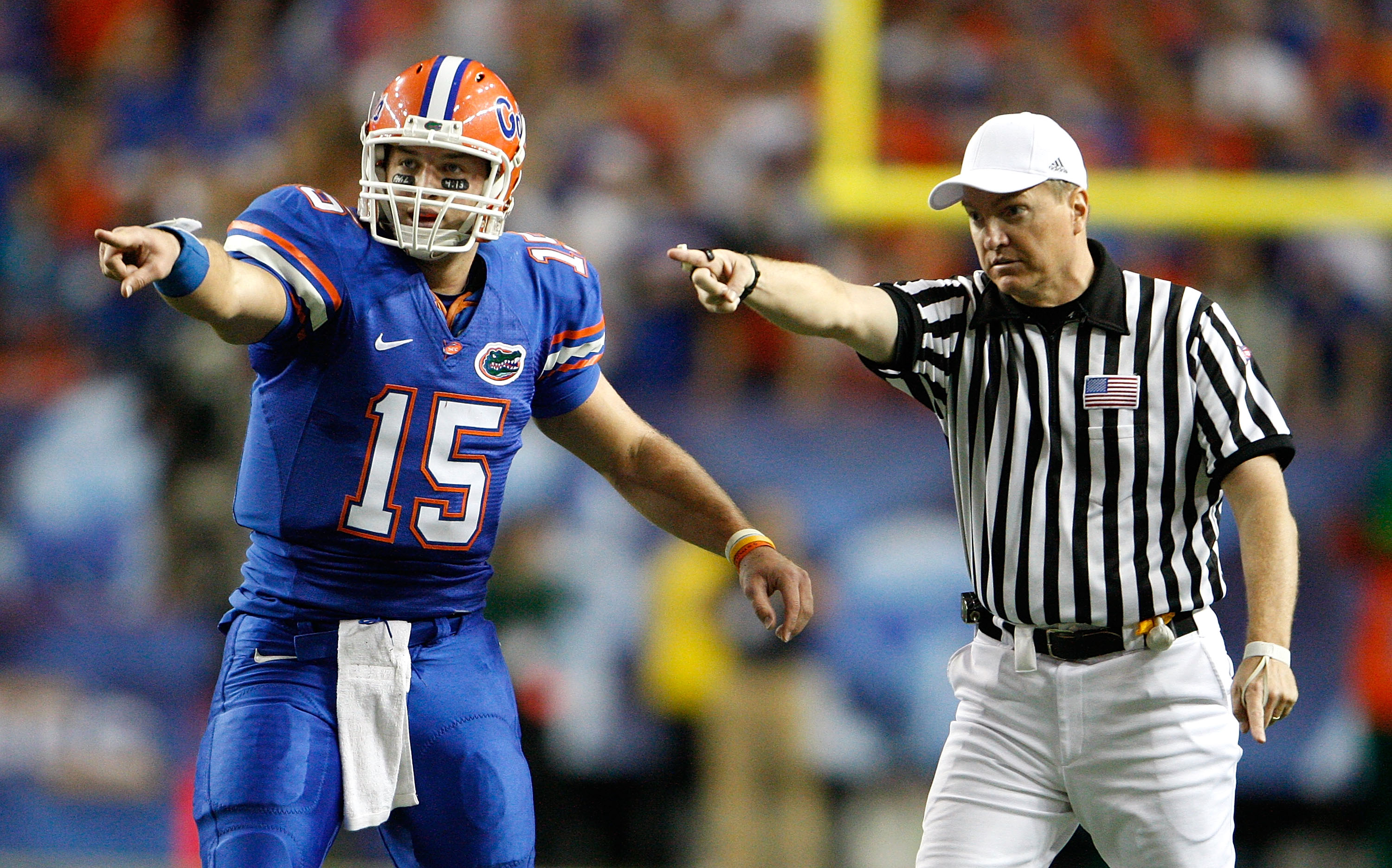 ATLANTA - DECEMBER 06:  Quarterback Tim Tebow #15 of the Florida Gators points with referee Tom Ritter at the first down against the Alabama Crimson Tide during the SEC Championship on December 6, 2008 at the Georgia Dome in Atlanta, Georgia.  (Photo by K