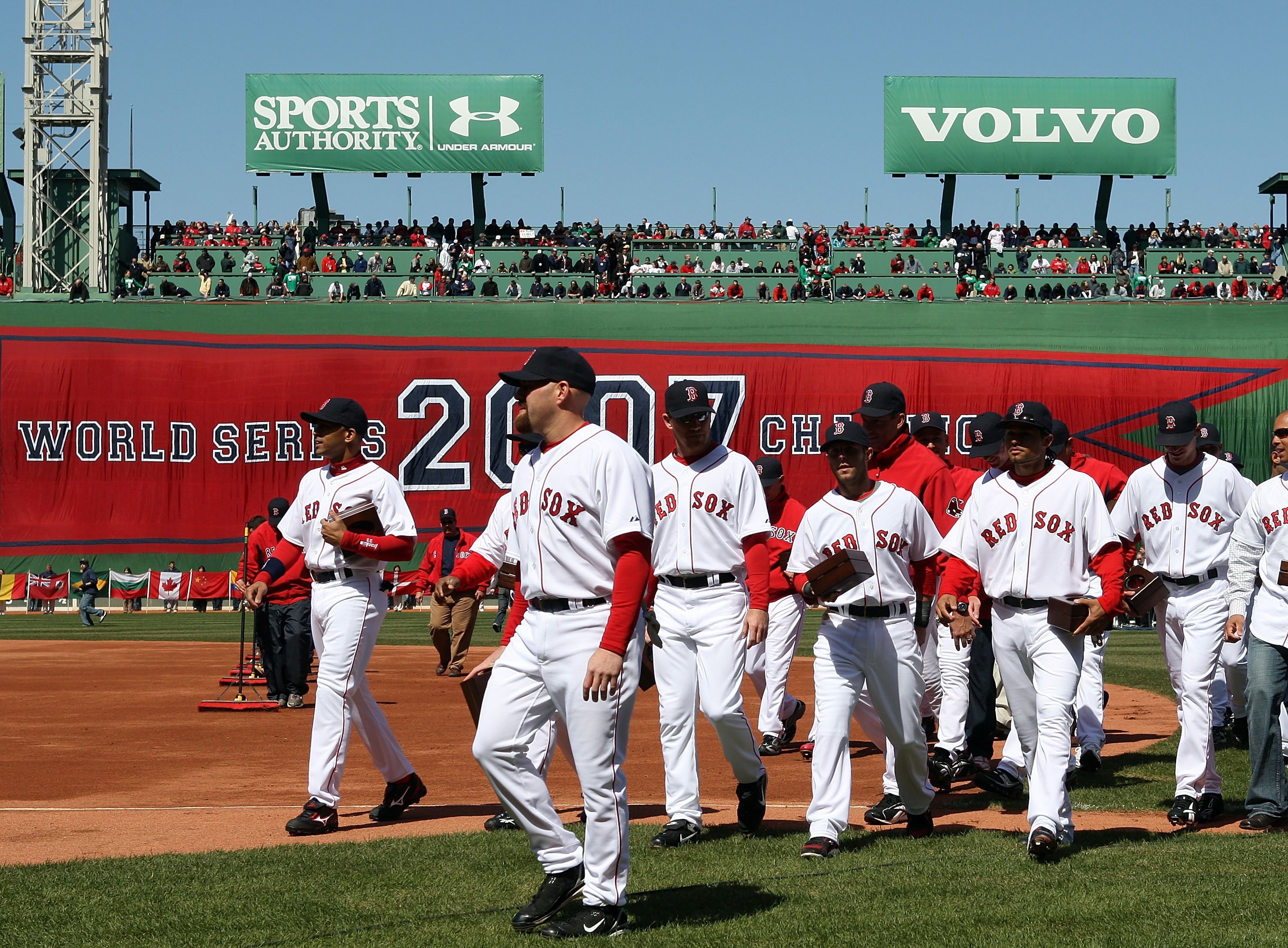 BOSTON - APRIL 08:  The Boston Red Sox  head to the dugout after raising the 2007 World Series banner and carrying their championship rings before the game against the Detroit Tigers on April 8,2008 during Opening Day at Fenway Park in Boston, Massachuset