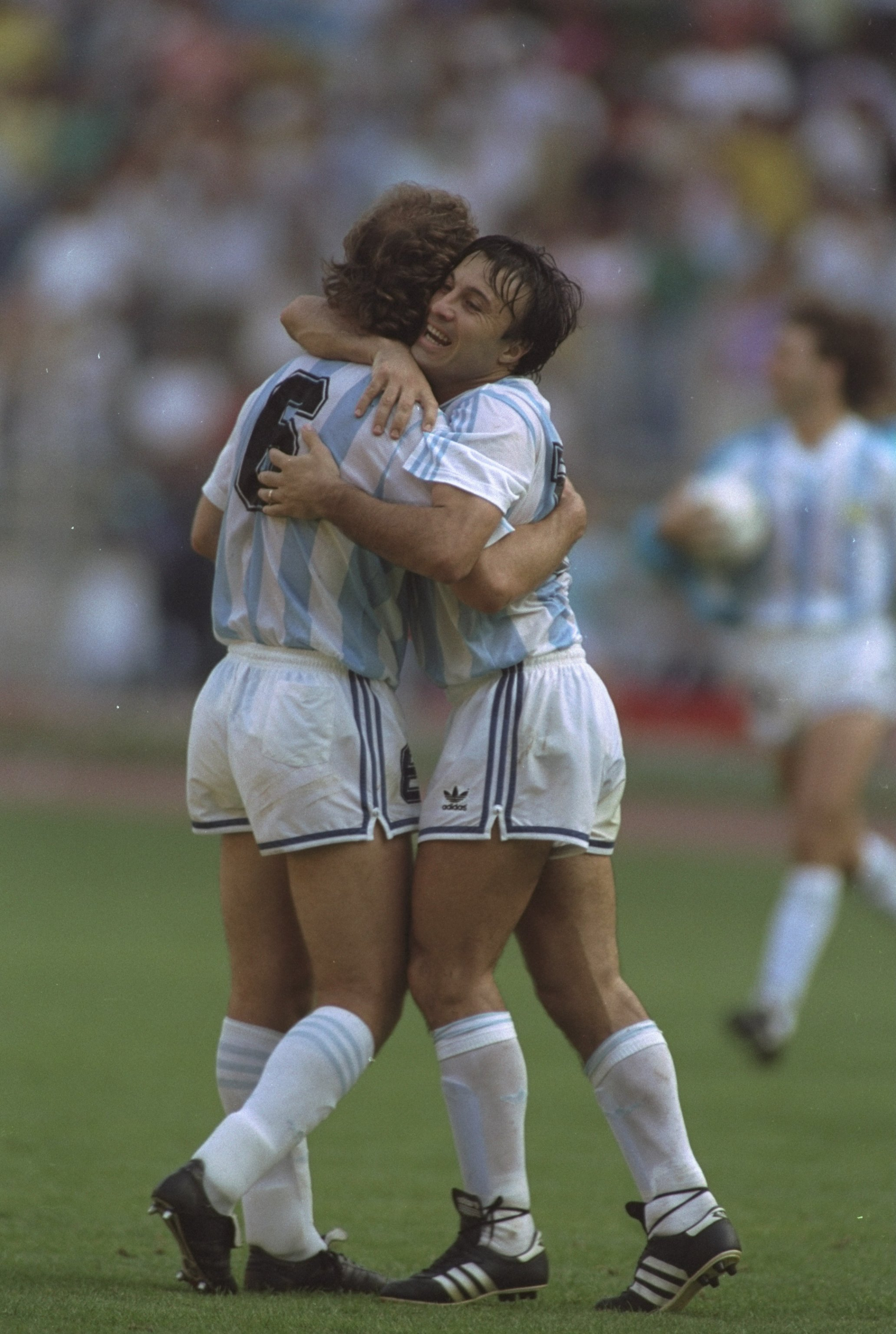 24 Jun 1990:  Jorge Olarticoehea (left) and Gabriel Calderon (right) both of Argentina hug in celebration after their win against Brazil in the World Cup match in Turin, Italy. Argentina won the match 1-0. \ Mandatory Credit: Simon  Bruty/Allsport