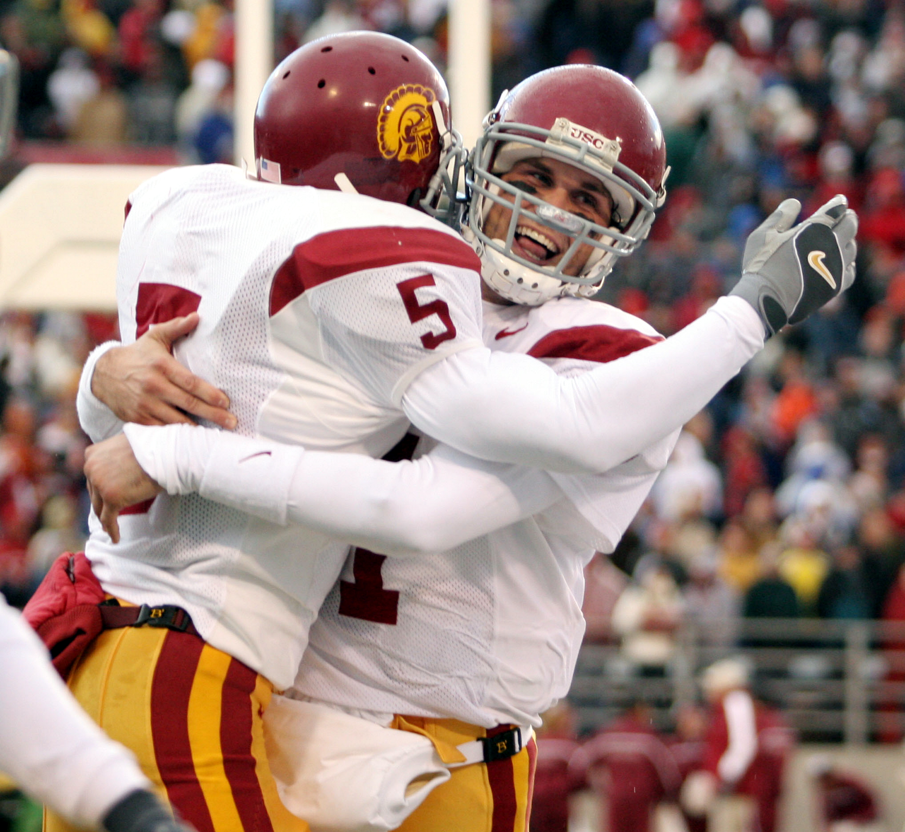 PULLMAN, WA - OCTOBER 30:  Running back Reggie Bush #5 of the USC Trojans celebrates with quarterback Matt Leinart #11 after scoring a touchdown against the Washington State Cougars on October 30, 2004 at Martin Stadium in Pullman, Washington.  (Photo by