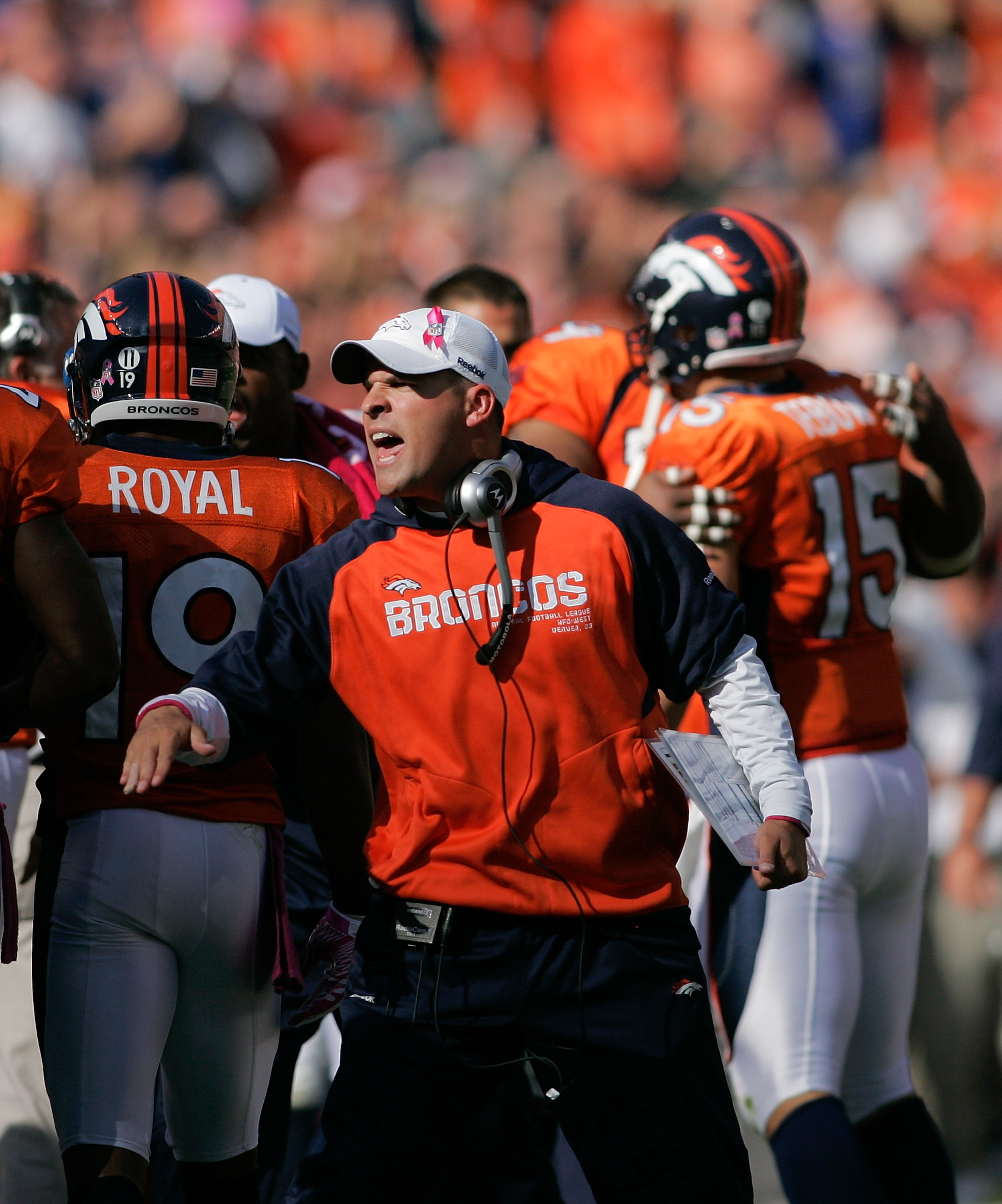 DENVER - OCTOBER 17:  Head coach Josh McDaniels of the Denver Broncos celebrates a touchdown by quarterback Tim Tebow #15 in the first half against the New York Jets at INVESCO Field at Mile High on October 17, 2010 in Denver, Colorado.  (Photo by Justin