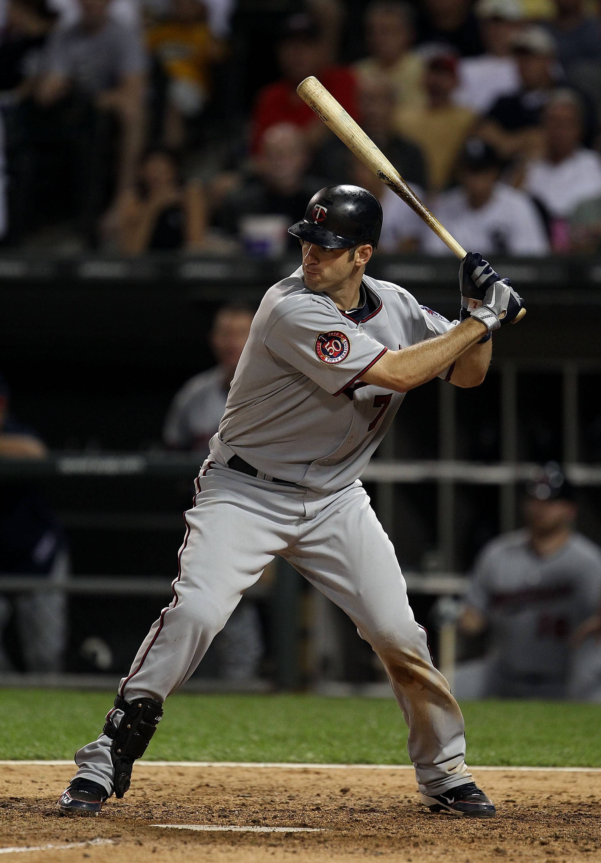 CHICAGO - AUGUST 10: Joe Mauer #7 of the Minnesota Twins prepares to bat against the Chicago White Sox at U.S. Cellular Field on August 10, 2010 in Chicago, Illinois. The Twins defeated the White Sox 12-6. (Photo by Jonathan Daniel/Getty Images)