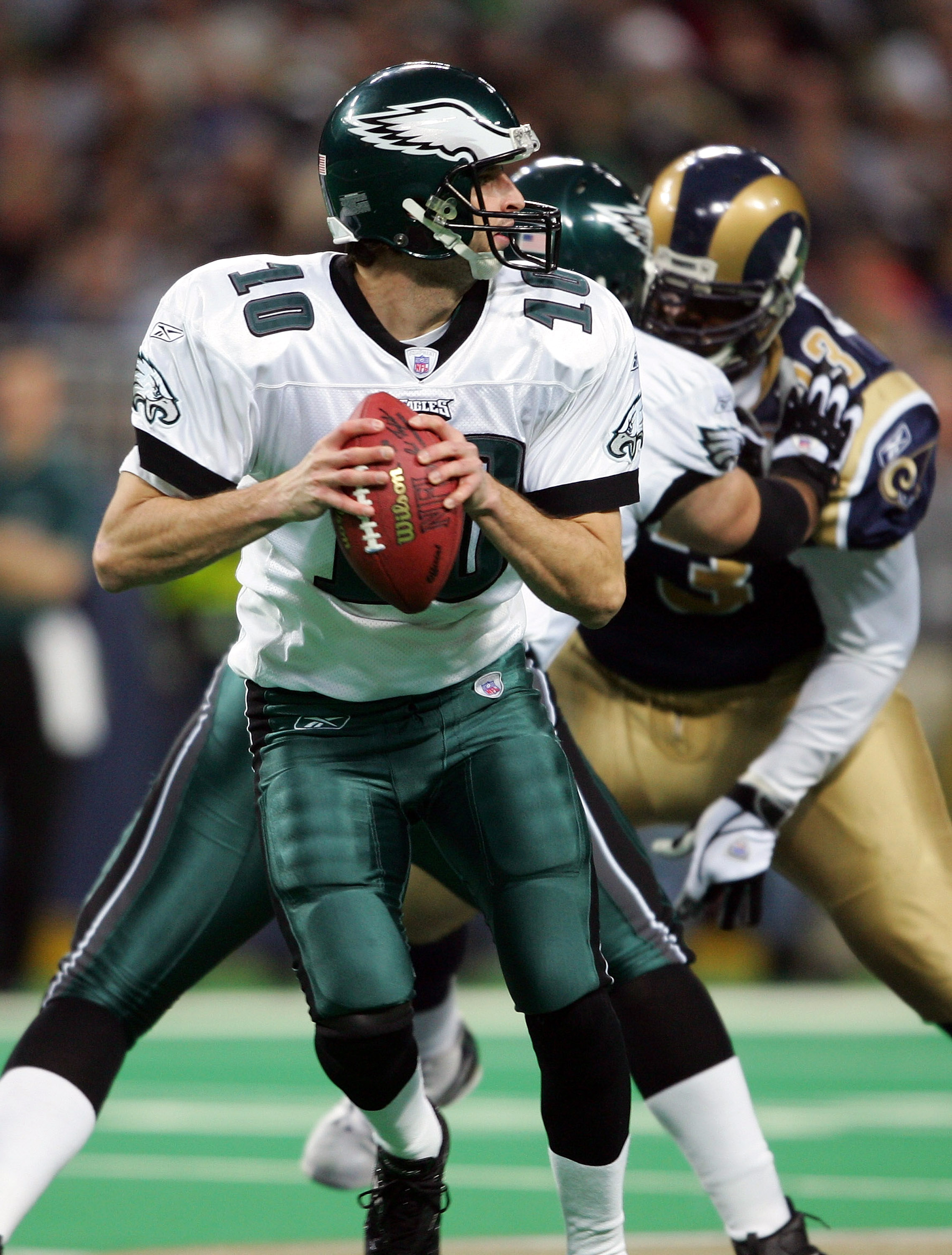 ST.LOUIS - DECEMBER 27:  Koy Detmer #10 of the Philadelphia Eagles drops back to pass  against the St. Louis Rams on December 27, 2004 at the Edward Jones Dome in St. Louis, Missouri.  (Photo by Elsa/Getty Images)