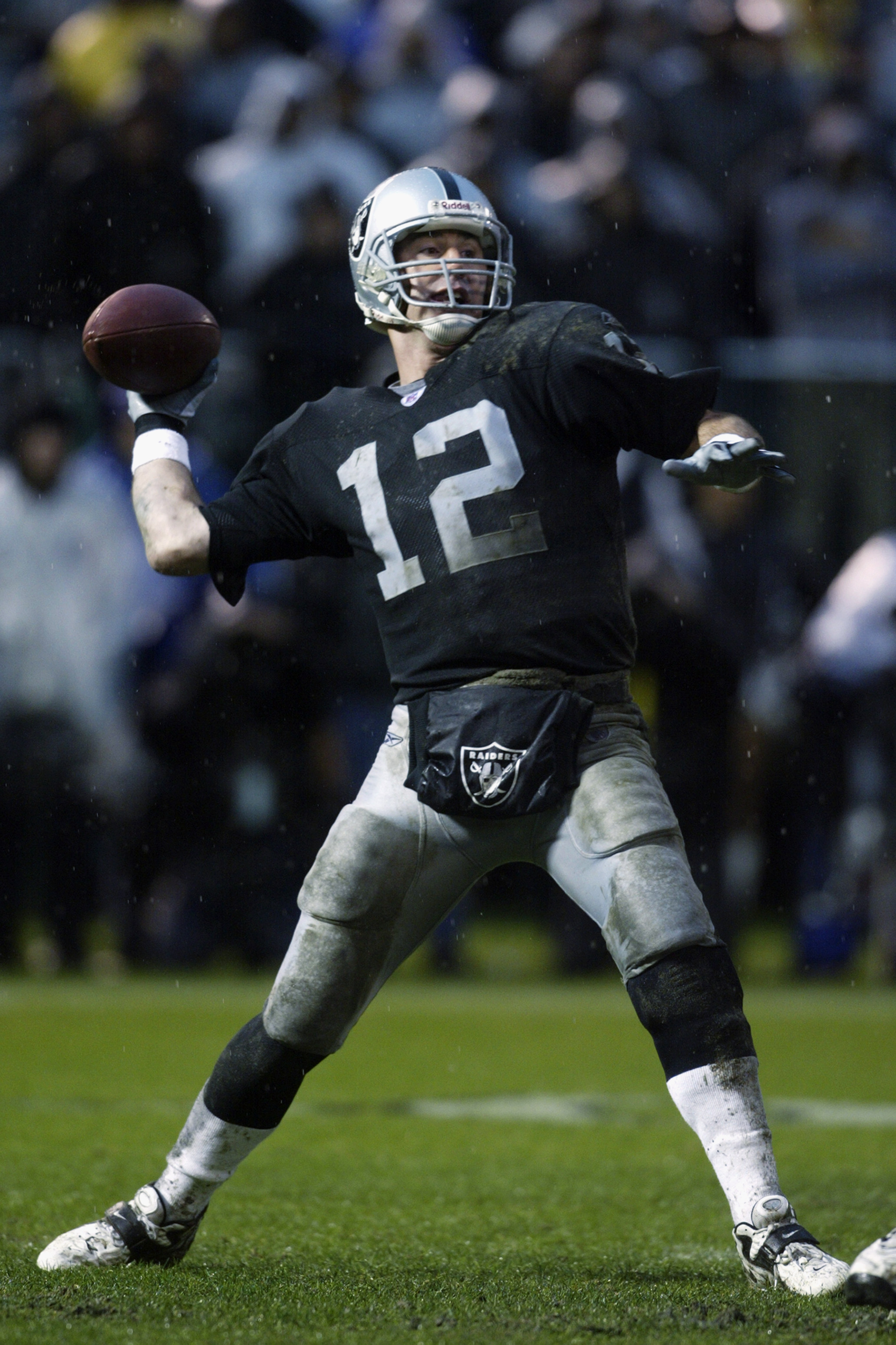 OAKLAND, CA - DECEMBER 28:  Rich Gannon #12 of the Oakland Raiders throws a pass against the Kansas City Chiefs during an NFL game at the Network Associates Coliseum on December 28, 2002 in Oakland, California.  The Raiders defeated the Chiefs 24-0. (Phot