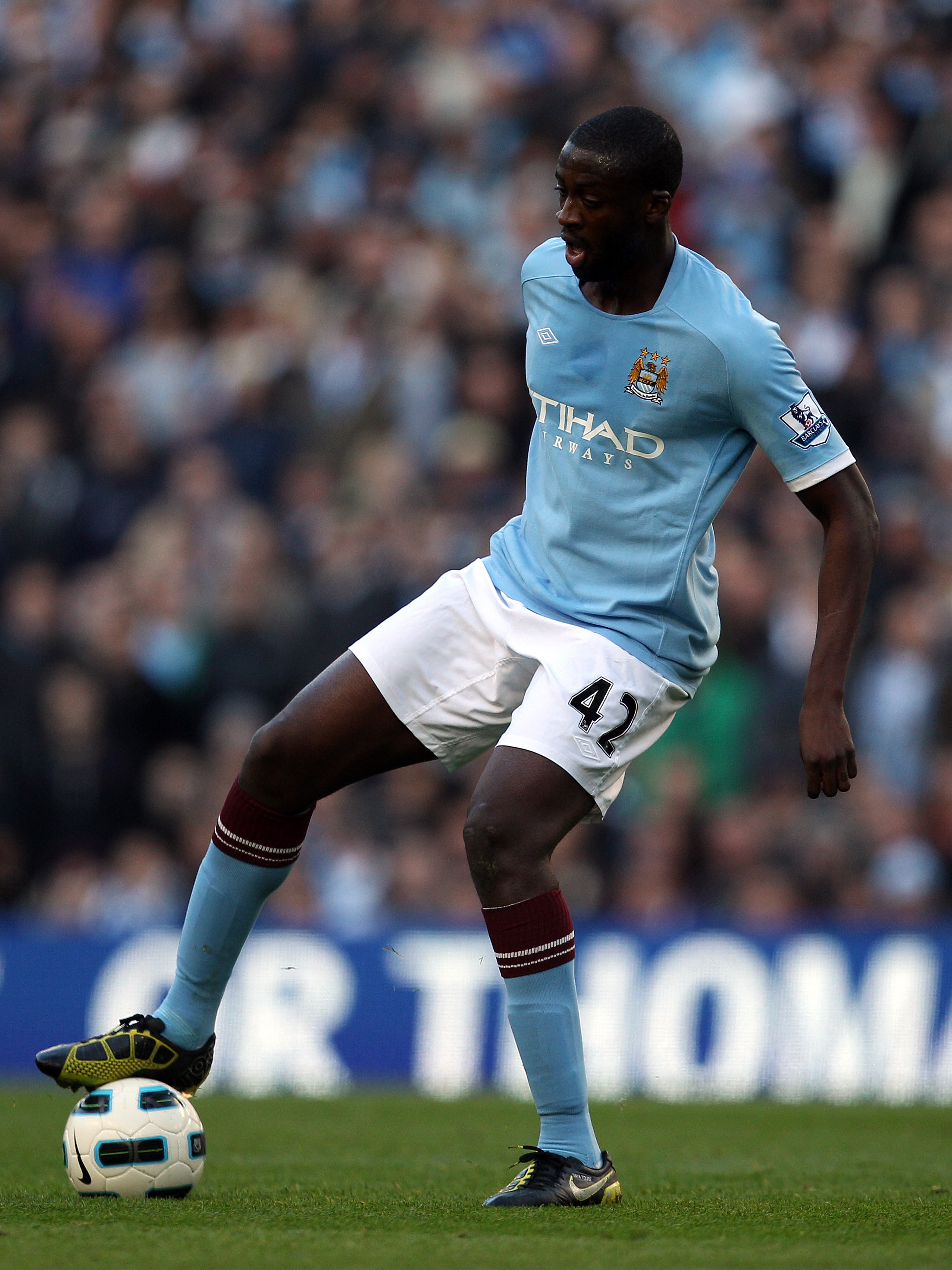 MANCHESTER, ENGLAND - OCTOBER 24:  Yaya Toure in action during the Barclays Premier League match between Manchester City and Arsenal at City of Manchester Stadium on October 24, 2010 in Manchester, England.  (Photo by Richard Heathcote/Getty Images)