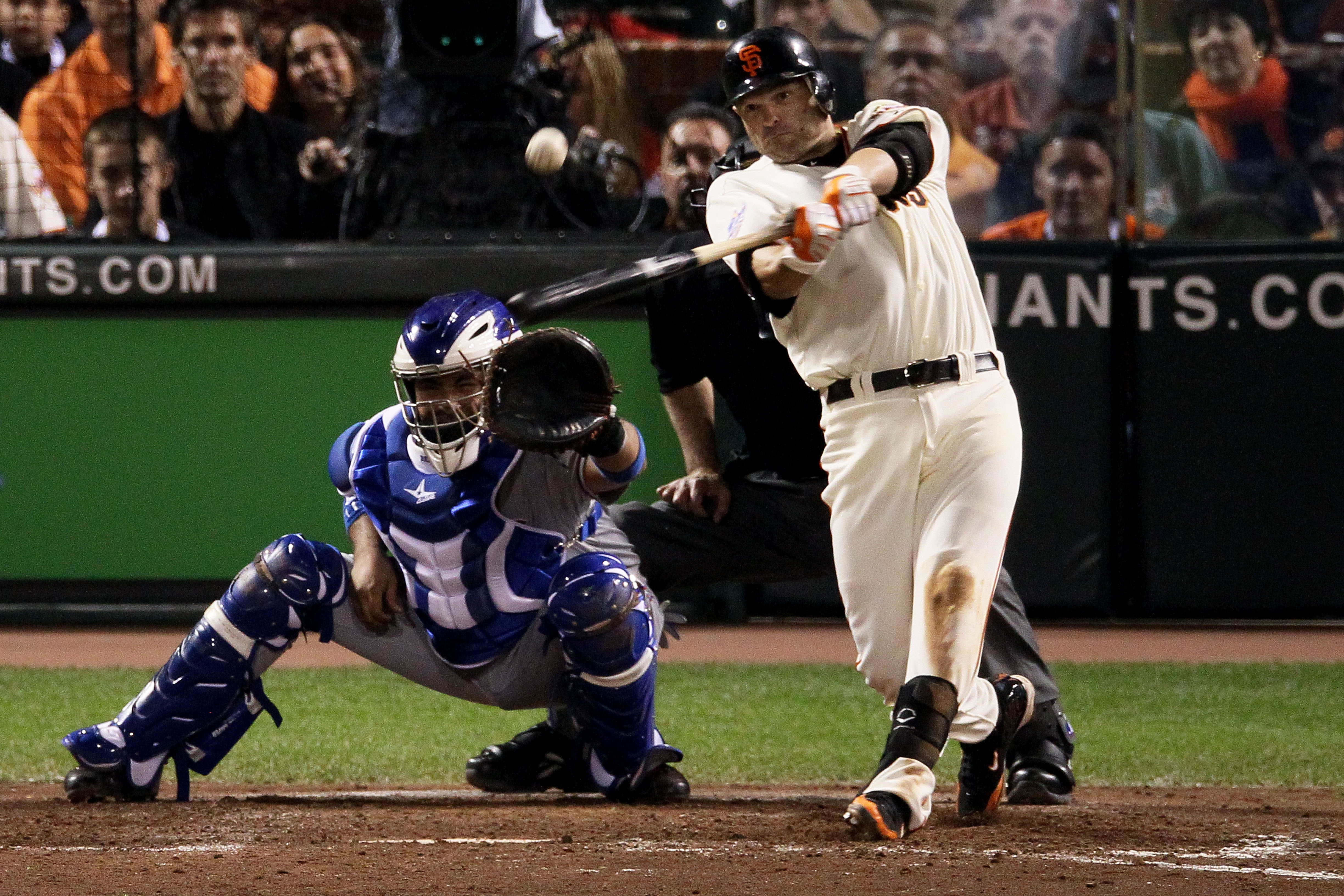 SAN FRANCISCO - OCTOBER 27:  Freddy Sanchez #21 of the San Francisco Giants hits an RBI double in the fifth inning against the Texas Rangers in Game One of the 2010 MLB World Series at AT&T Park on October 27, 2010 in San Francisco, California.  (Photo by