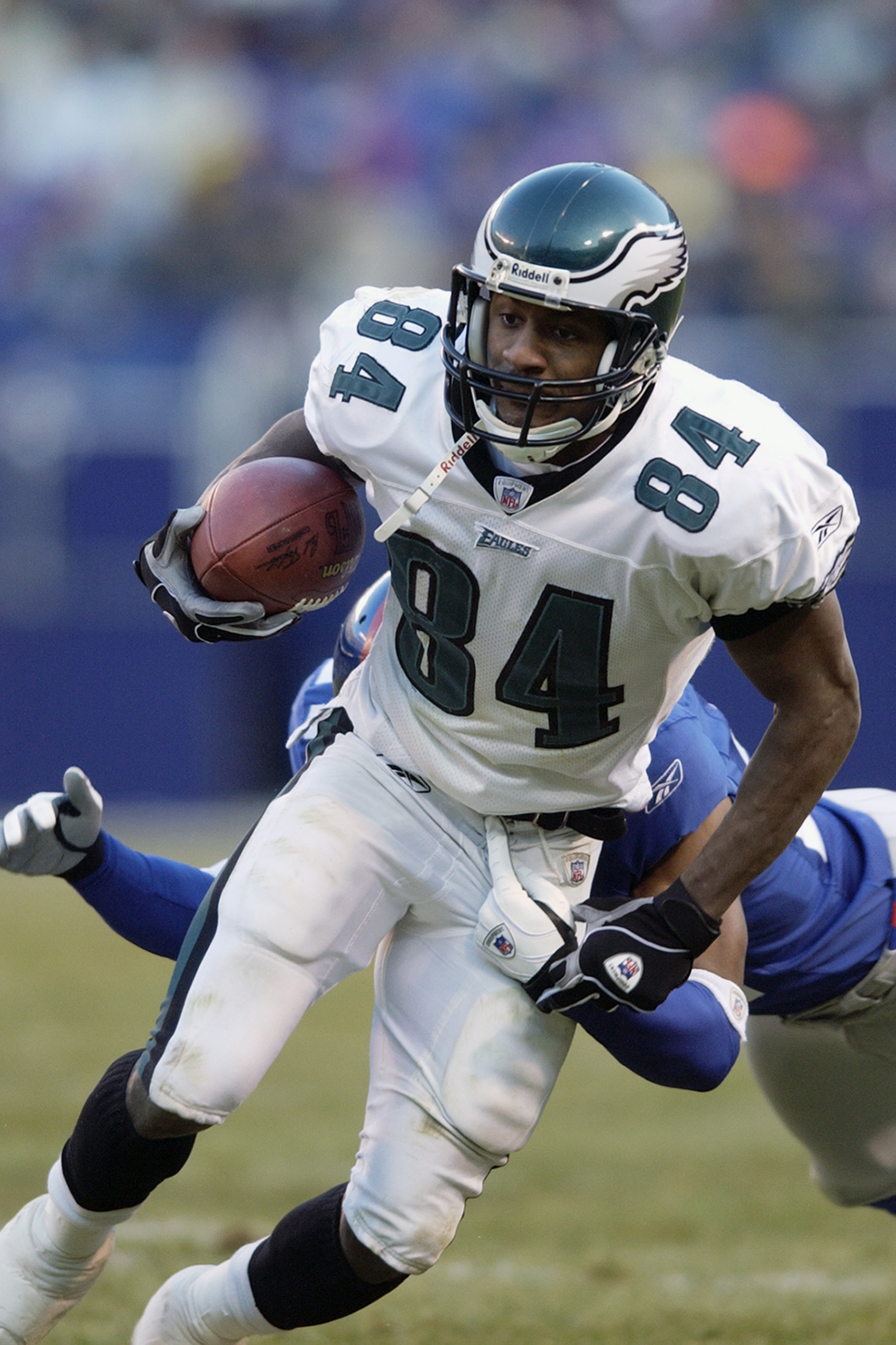 EAST RUTHERFORD, NJ - DECEMBER 28:  Wide receiver Freddie Mitchell #84 of the Philadelphia Eagles carries the ball against the New York Giants during the game at Giant Stadium on December 28, 2002 in East Rutherford, New Jersey. The Giants defeated the Ea