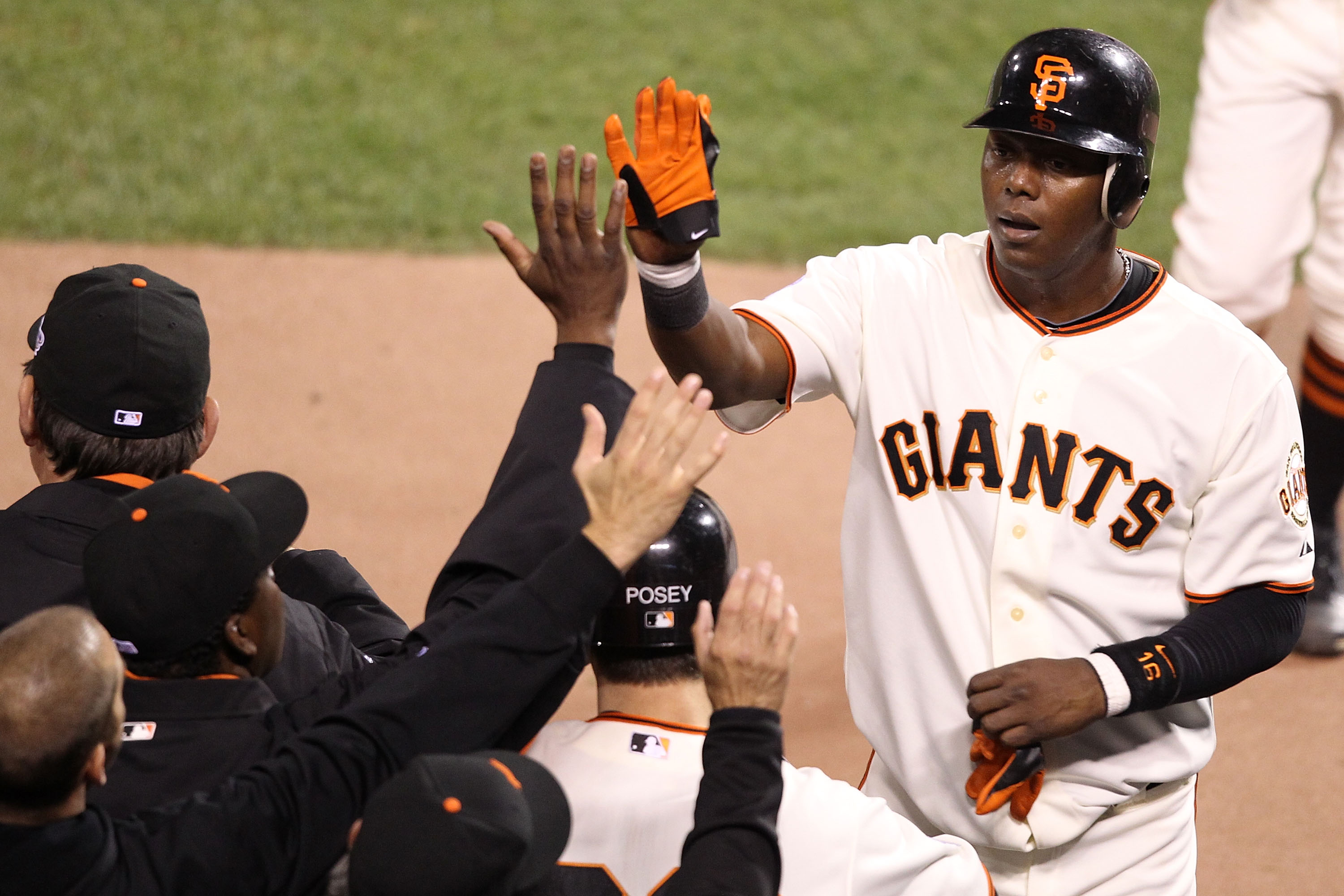 SAN FRANCISCO - OCTOBER 27:  Edgar Renteria #16 of the San Francisco Giants celebrates after scoring in the eighth inning against the Texas Rangers in Game One of the 2010 MLB World Series at AT&T Park on October 27, 2010 in San Francisco, California.  (P