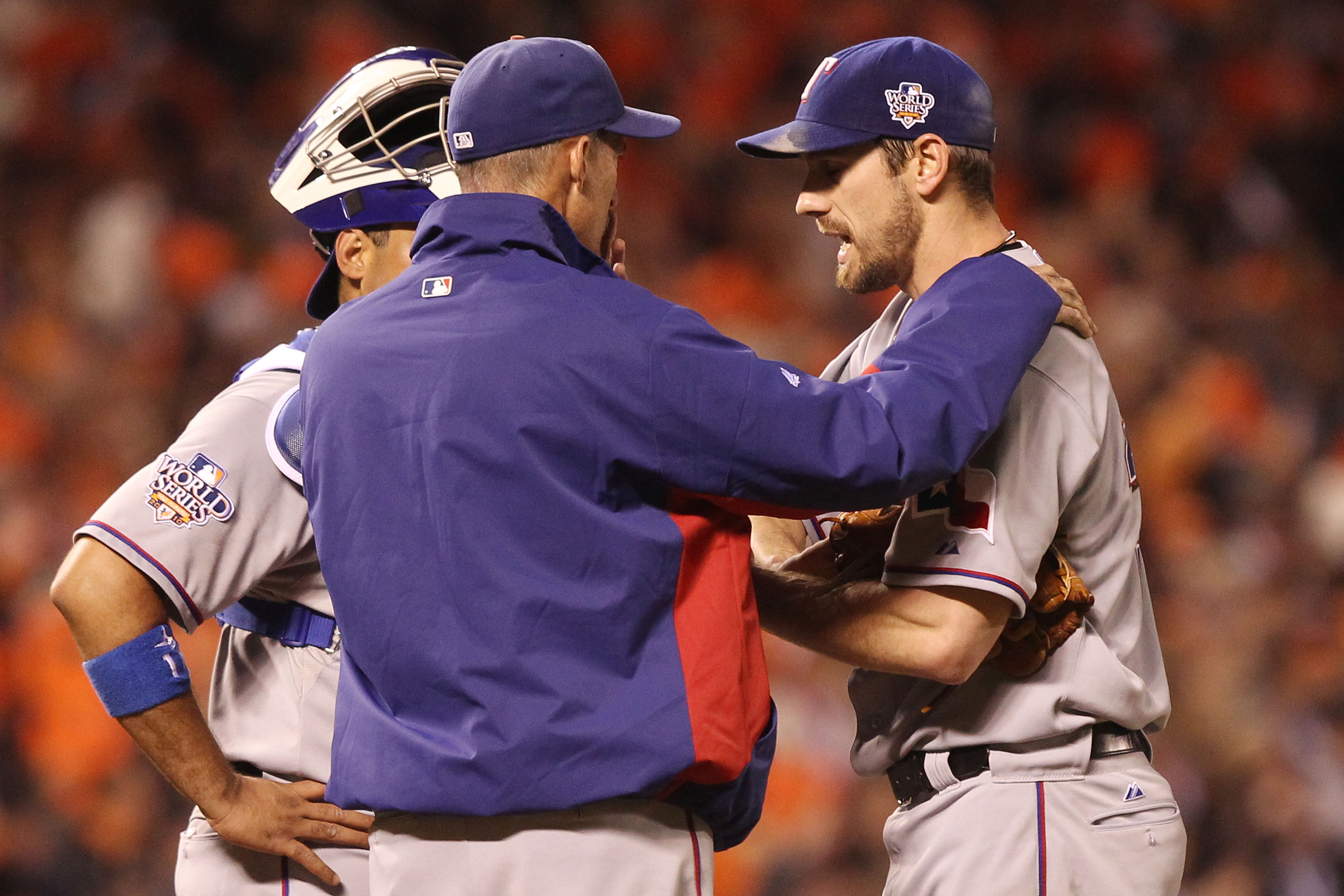 SAN FRANCISCO - OCTOBER 27:  Pitching coach Mike Maddux talks with Cliff Lee #33 of the Texas Rangers against the San Francisco Giants in Game One of the 2010 MLB World Series at AT&T Park on October 27, 2010 in San Francisco, California.  (Photo by Jed J